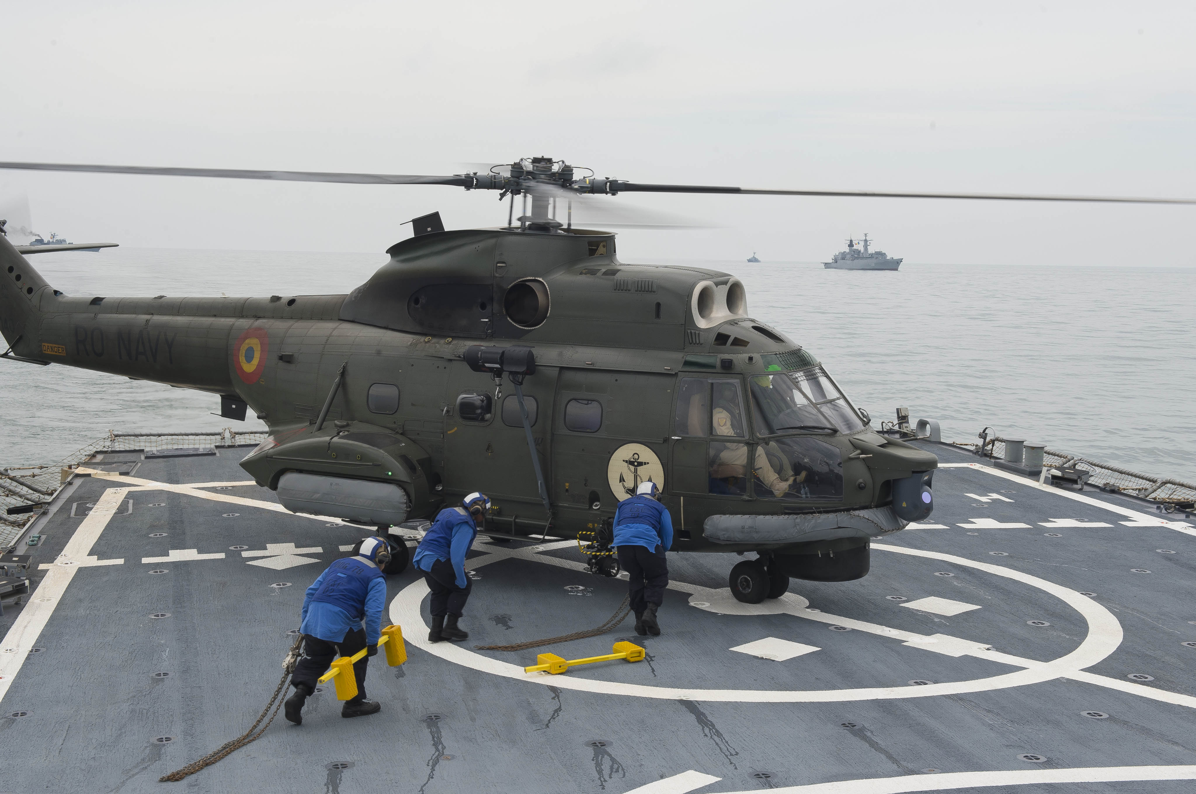 A Romanian navy IAR-330 medium helicopter lands aboard USS Porter (DDG 78) during a passing exercise in the Black Sea on June 13, 2016. Porter is forward-deployed to Rota, Spain for routine patrols in the U.S. 6th Fleet area of operations. US Navy photo.