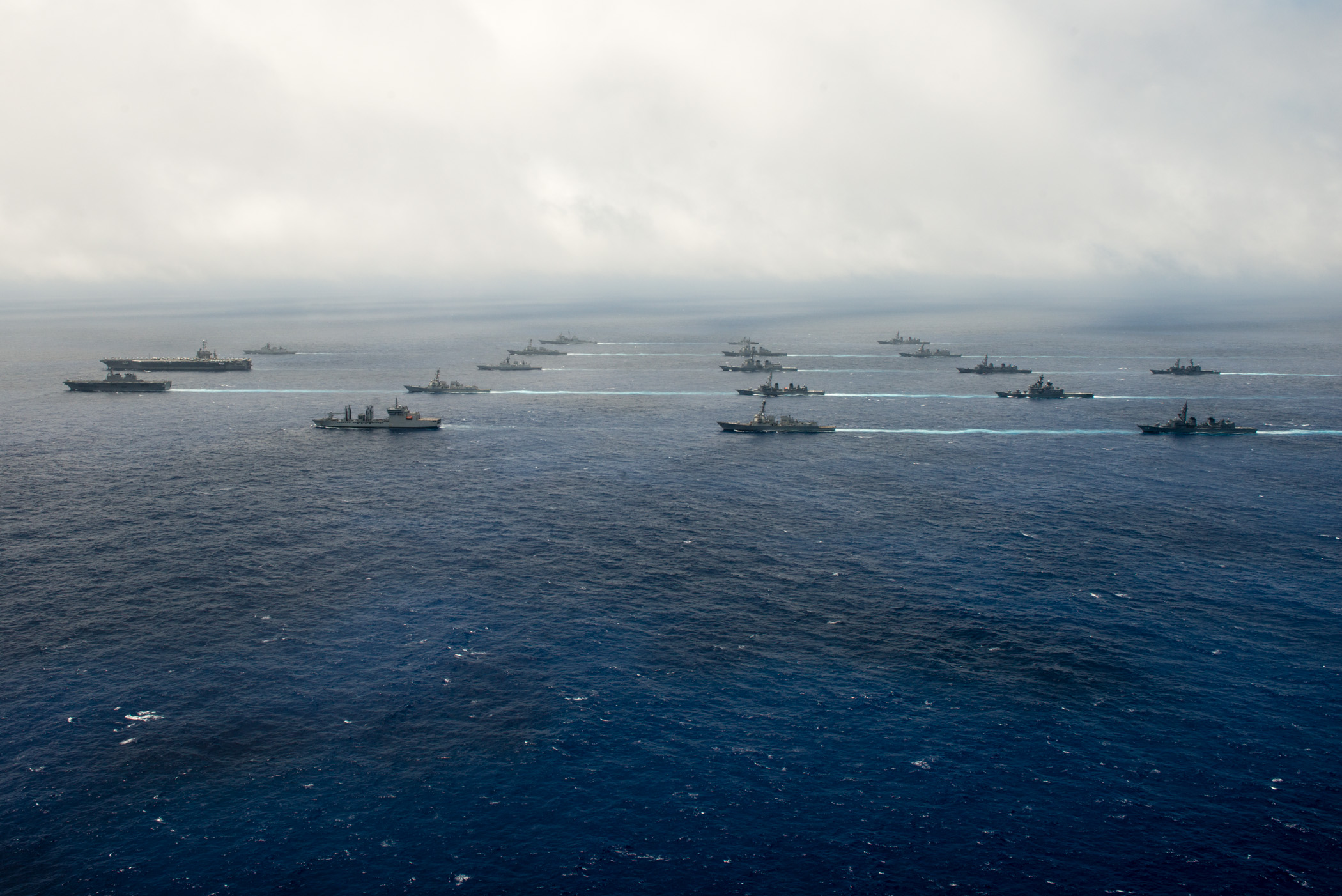Malabar 2016 participants from the Indian Navy, Japanese Maritime Self-Defense Force (JMSDF), and U.S. Navy sail in formation. US Navy photo.