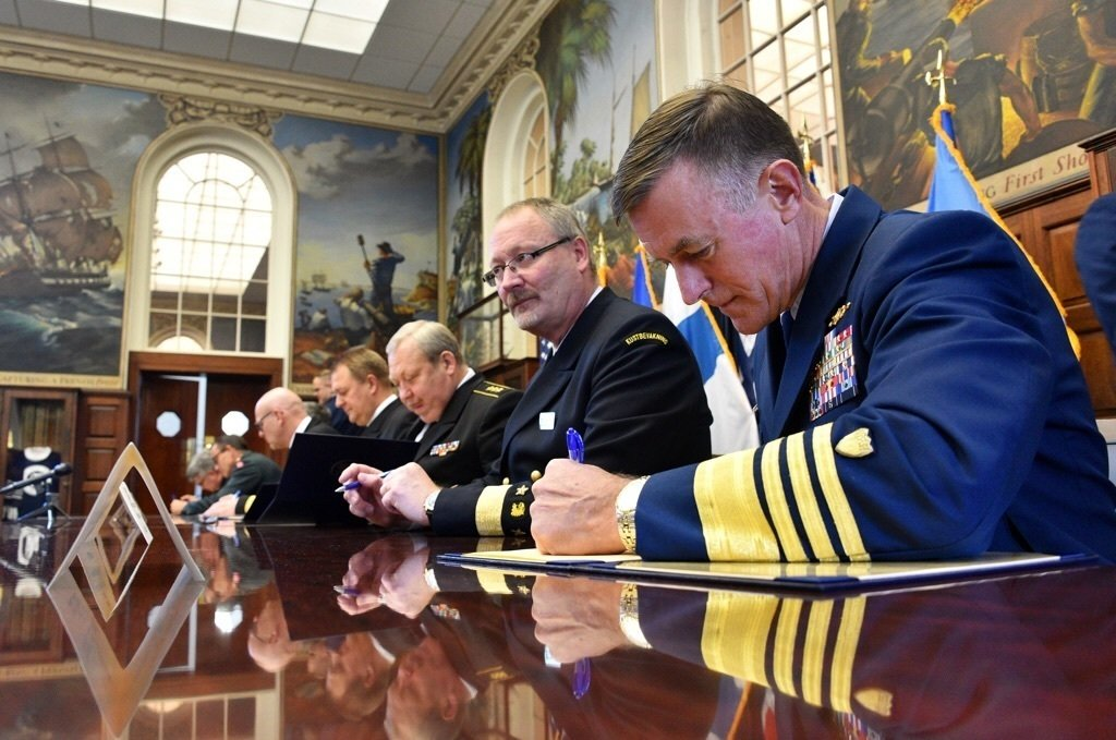 Coast Guard Commandant Adm. Paul Zukunft joins leaders representing all eight coast guard agencies of the Arctic nations to sign a Joint Statement officially establishing the Arctic Coast Guard Forum at the Coast Guard Academy in New London, Conn., Oct. 30, 2015. US Coast Guard photo.
