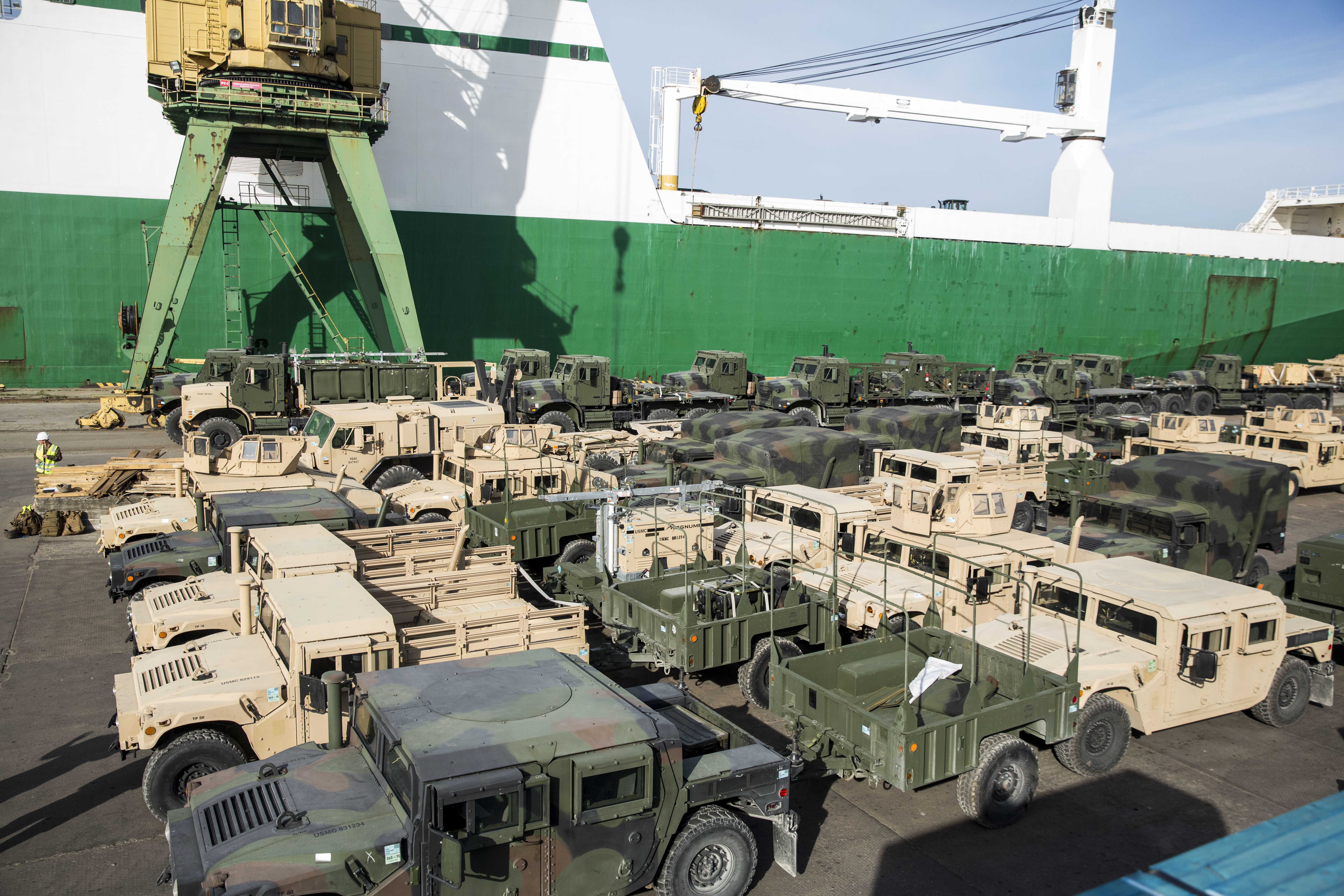 A fleet of military vehicles wait pier side in preparation of Exercise Saber Strike 16 in Riga, Latvia, June 4, 2016. The vehicles were transported by a British Roll-On, Roll-Off ship from Norway for the exercise. US Marine Corps photo.