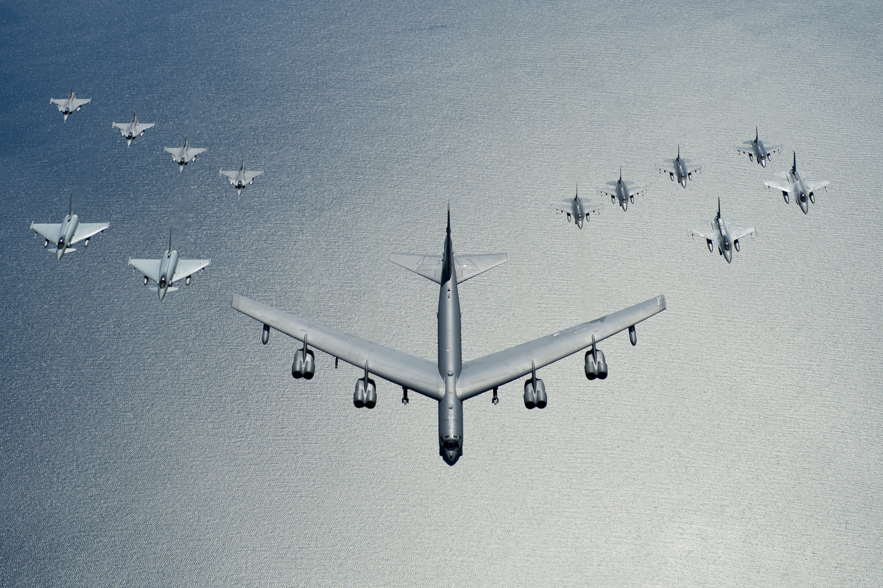 A United States Air Force B52 Stratofortress leads a formation of aircraft including two Polish air force F16 Fighting Falcons, four U.S. Air Force F16 Fighting Falcons, two German Eurofighter Typhoons and four Swedish Gripens over the Baltic Sea, June 9, 2016. US Air Force photo.