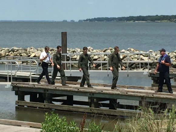 The three crew members from the MH-60S that crashed in the James River walked from the Newport News Police Department (NNPD) boat to an ambulance. NNPD photo.