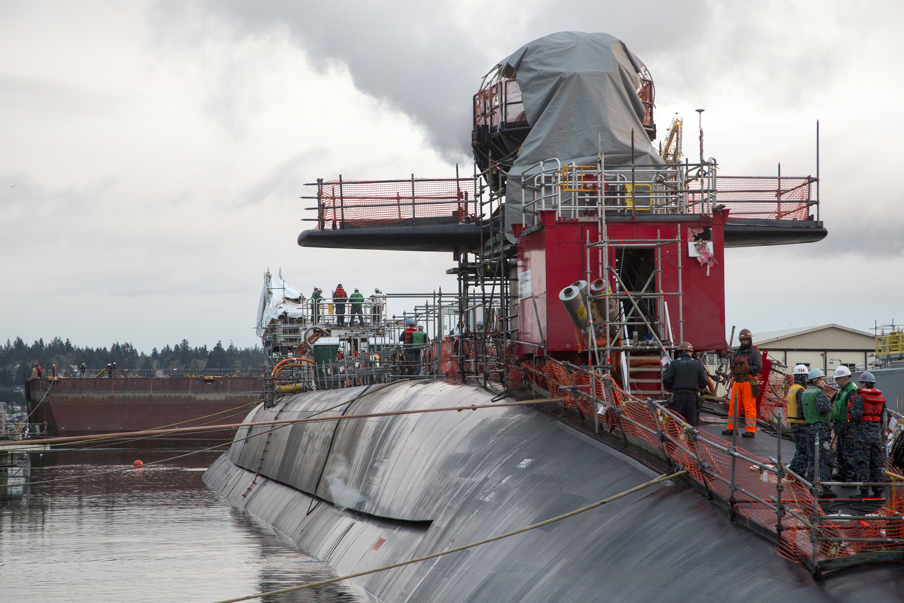 Ohio-class ballistic missile submarine USS Nebraska (SSBN 739) undocks from a dry dock at Puget Sound Navy Shipyard and Intermediate Maintenance Facility on March 8, 2016. US Navy photo.