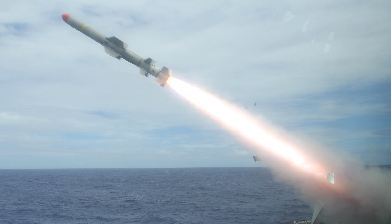 USS Coronado (LCS-4), an Independence-variant littoral combat ship, launches the first over-the-horizon missile engagement using a Harpoon Block 1C missile. US Navy Photo