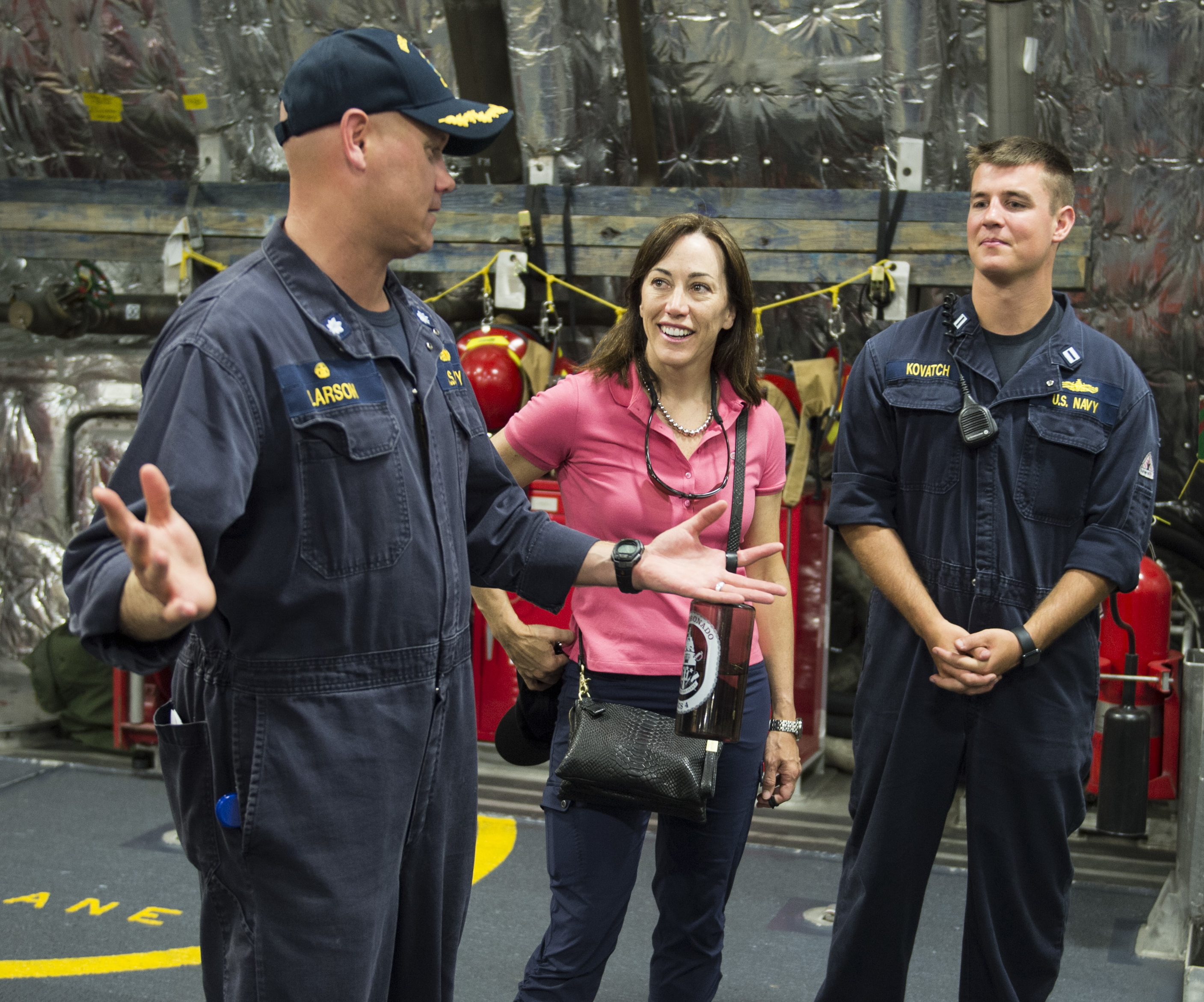 Cmdr. Scott Larson (left), Commanding Officer of littoral combat ship USS Coronado (LCS-4), gives Under Secretary of the Navy Janine A. Davidson a tour of the ship during Rim of the Pacific 2016. US Navy Photo