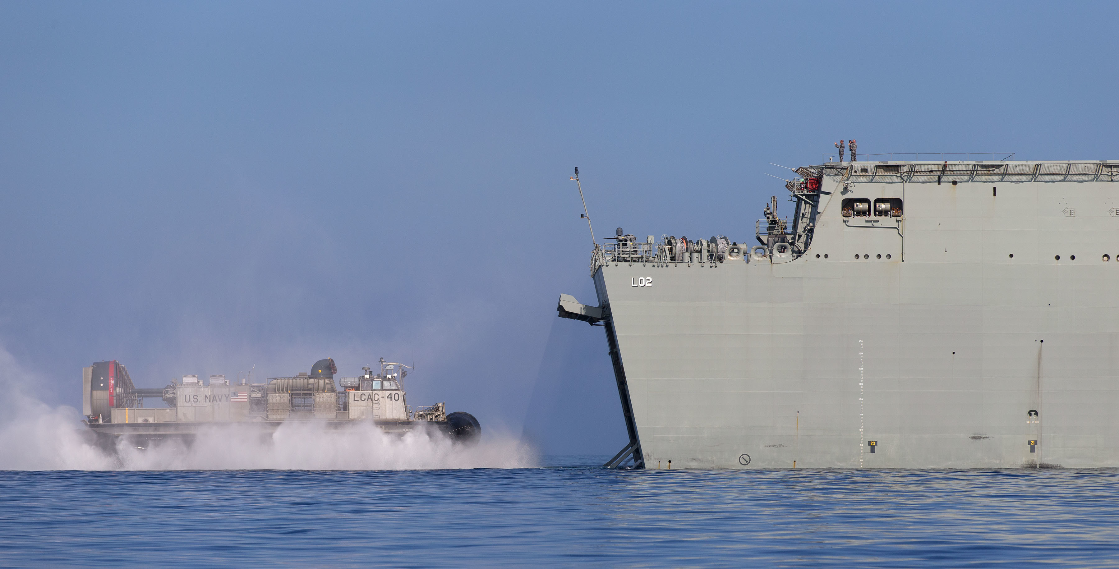 A U.S. Navy Landing Craft, Air Cushion (LCAC) from amphibious transport dock USS San Diego (LPD 22) enters the well dock of HMAS Canberra off the coast of Hawaii during interoperability training in Rim of the Pacific 2016. Royal Australian Navy photo.