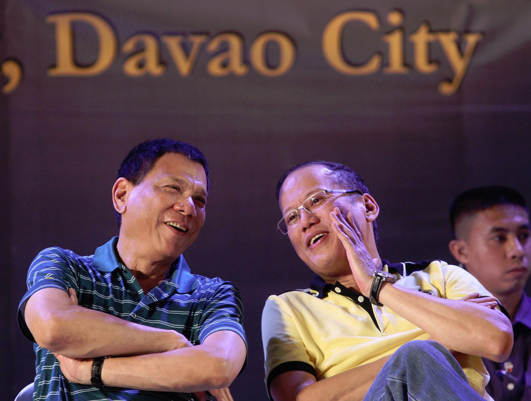 Former Philippine President Benigno S. Aquino III converses with then Davao City Vice Mayor Rodrigo Duterte in 2013.