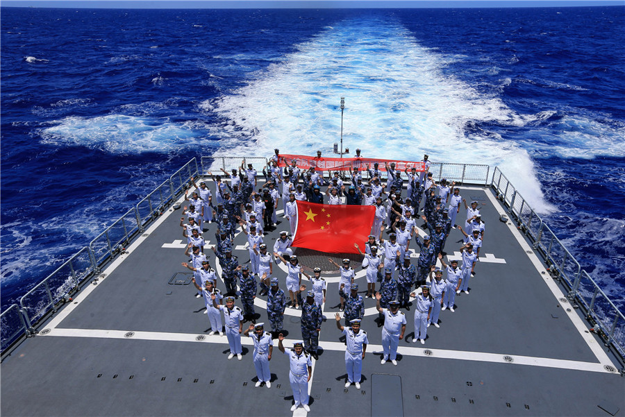 Chinese sailors aboard the People's Liberation Army Navy destroyer Xi'an pose on the flight deck in route to RIMPAC 2016 after crossing the International Dateline. Xinhua Photo