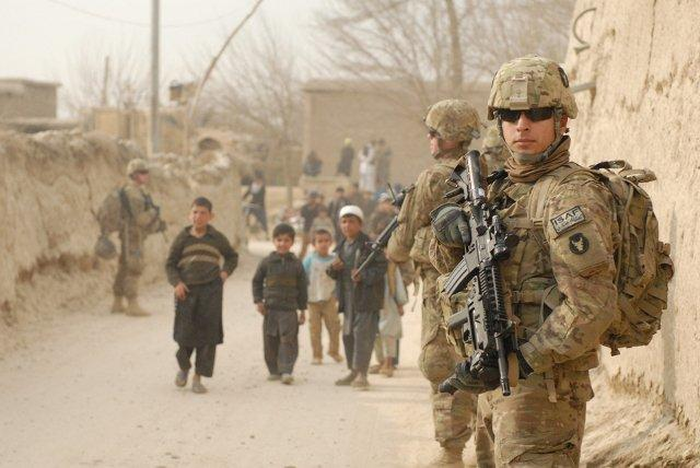 Soldiers of the personal security detachment for Headquarters and Headquarters Troop, 1st Squadron, 113th Cavalry Regiment, Task Force Redhorse, patrol the villages in the Bagram Security Zone in 2011. US Army Photo