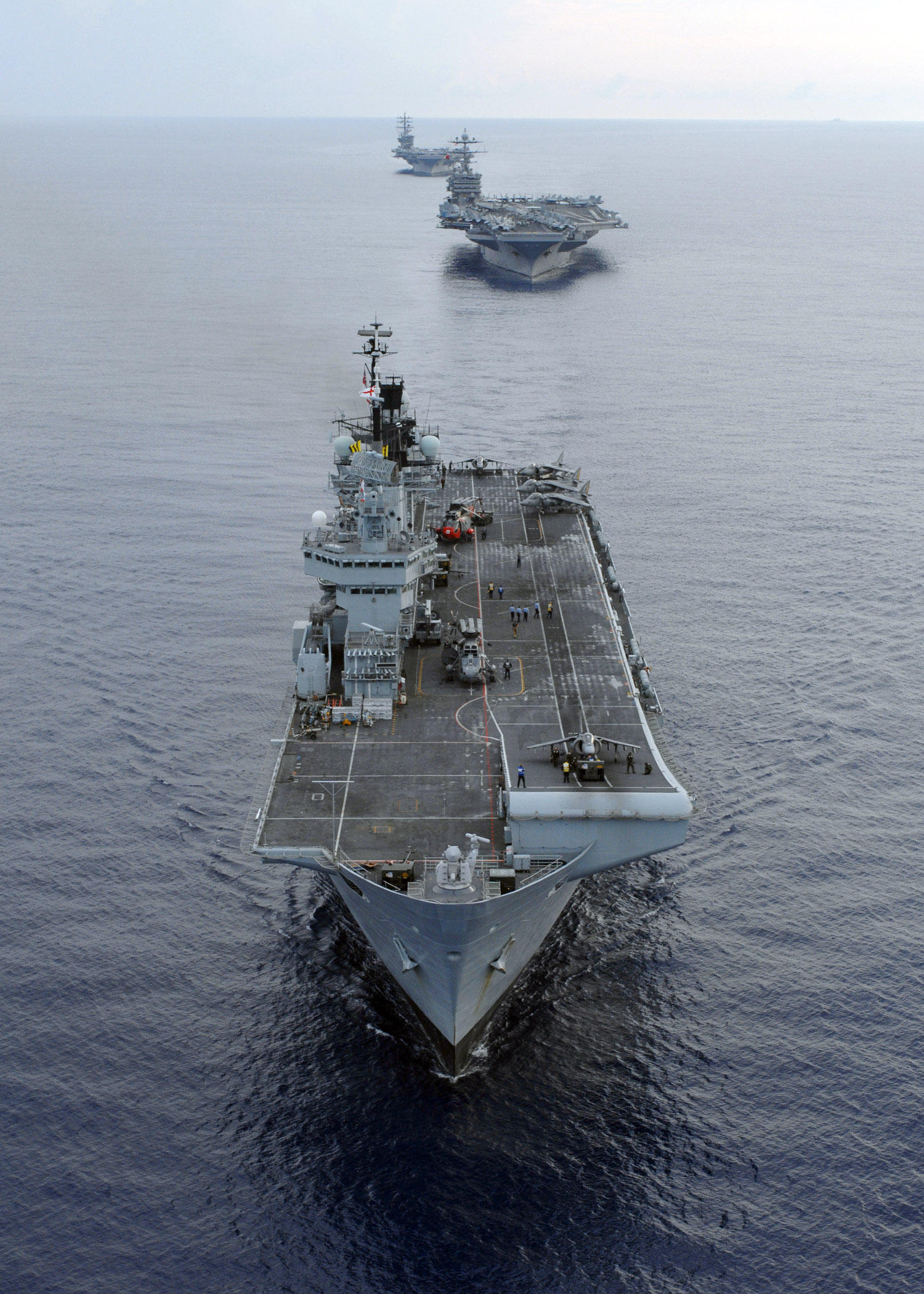 The U.K. Royal Navy Invincible-class aircraft carrier HMS Illustrious (R 06), and Nimitz-class aircraft carriers USS Harry S. Truman (CVN-75) and USS Dwight D. Eisenhower (CVN-69) in 2007. US Navy Photo