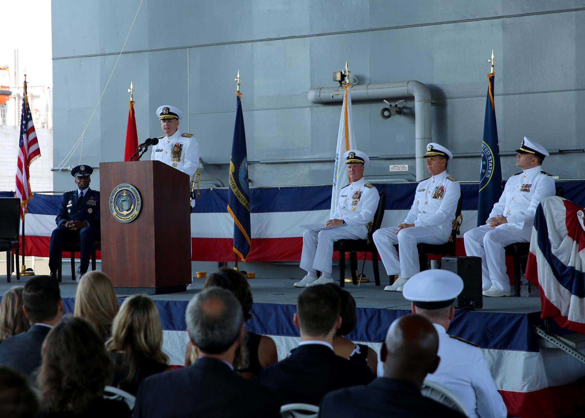 Rear Adm. Dee Mewbourne addresses the audience at Military Sealift Command's change of command ceremony aboard USNS Lewis B. Puller (T-ESB 3) on Aug. 25, 2016. US Navy photo.