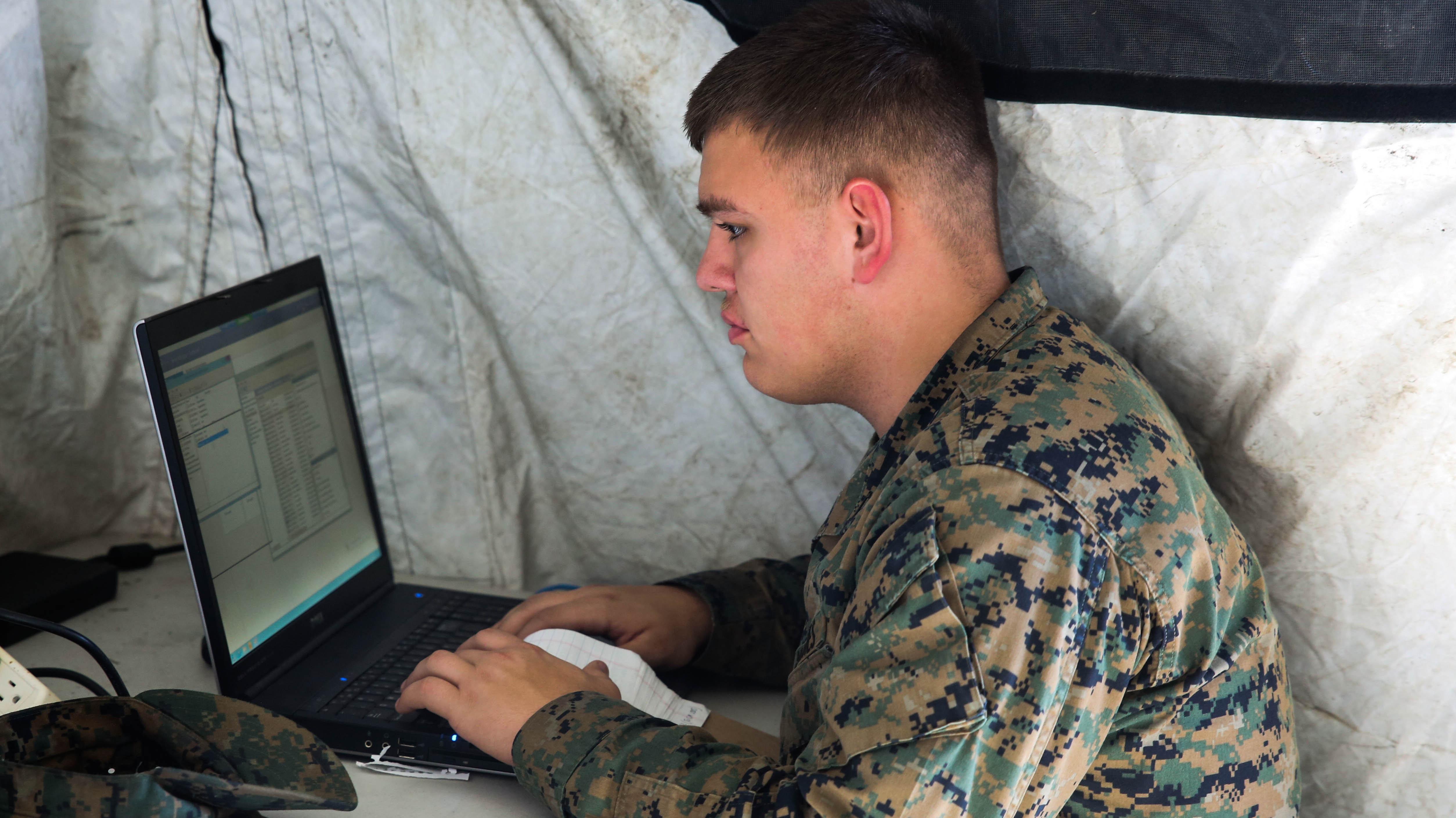 Pfc. Alec Rivera, a cyber-network specialist with Headquarters Company, Combat Logistics Regiment 25, works on a computer during a command post exercise at Camp Lejeune, N.C., Feb. 2, 2016. US Marine Corps Photo
