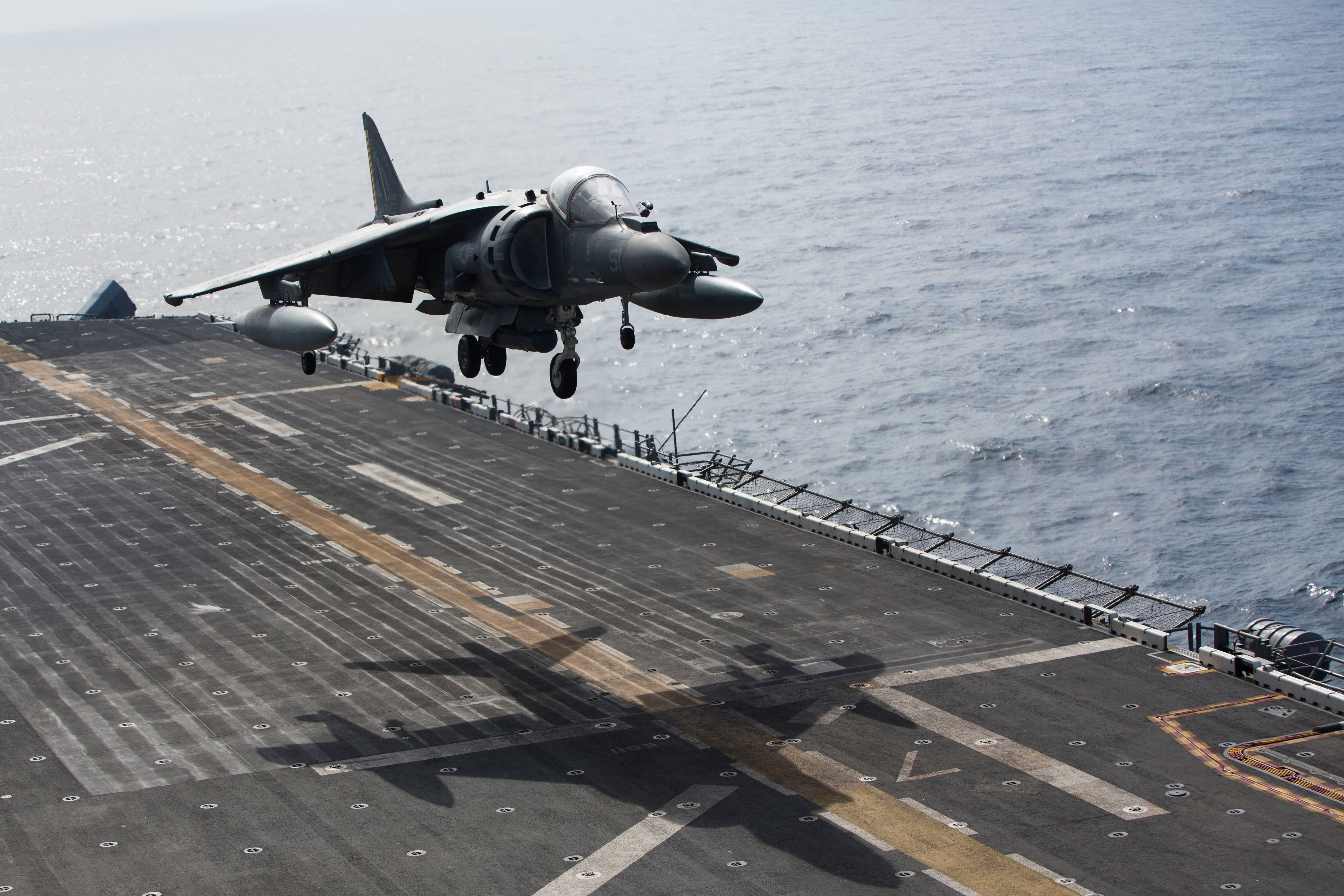 An AV-8B Harrier II with Marine Medium Tiltrotor Squadron 264 (Reinforced), 22nd Marine Expeditionary Unit (MEU), lands on the flight deck of the amphibious assault ship USS Wasp (LHD-1) on July 18, 2016. US Marine Corps