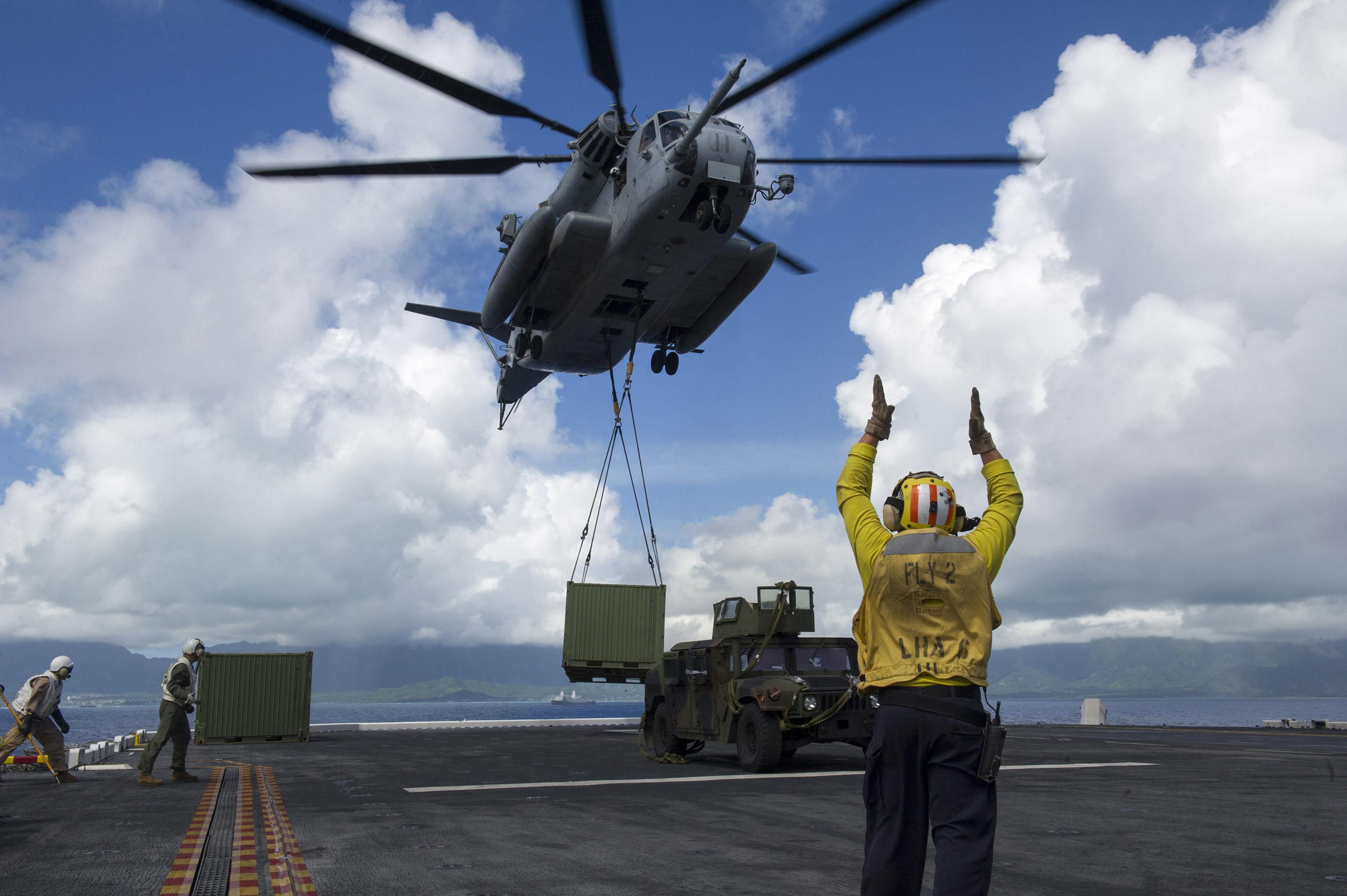 160730-N-VR008-210 PACIFIC OCEAN (July 30, 2016) – A CH-53E Super Stallion cargo helicopter assigned to Heavy Marine Helicopter Squadron (HMH) 463 lifts a supply container from the flight deck of the amphibious assault ship USS America (LHA 6). America is underway conducting maritime exercises with partner nations for Rim of the Pacific 2016. Twenty-six nations, more than 40 ships and submarines, more than 200 aircraft and 25,000 personnel are participating in RIMPAC from June 30 to Aug. 4, in and around the Hawaiian Islands and Southern California. The world's largest international maritime exercise, RIMPAC provides a unique training opportunity that helps participants foster and sustain the cooperative relationships that are critical to ensuring the safety of sea-lanes and security on the world's oceans. RIMPAC 2016 is the 25th exercise in the series that began in 1971. (U.S. Navy photo by Mass Communication Specialist 3rd Class Kyle Goldberg/Released)