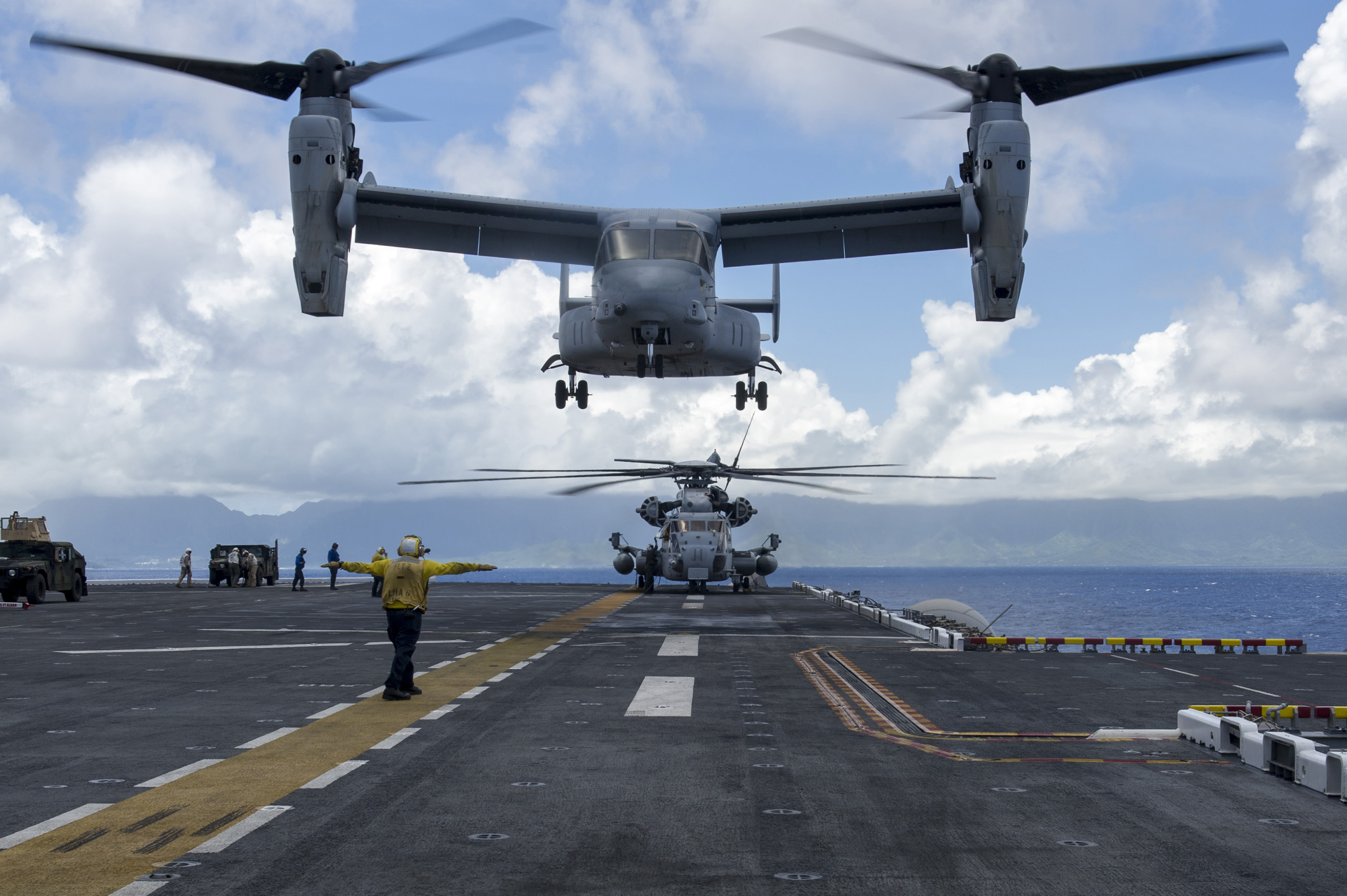"An MV-22 Osprey, assigned to the ""White Knights"" of Marine Medium Tiltrotor Squadron (VMM) 165, prepares to land aboard the amphibious assault ship USS America (LHA 6) during flight operations. US Navy photo."