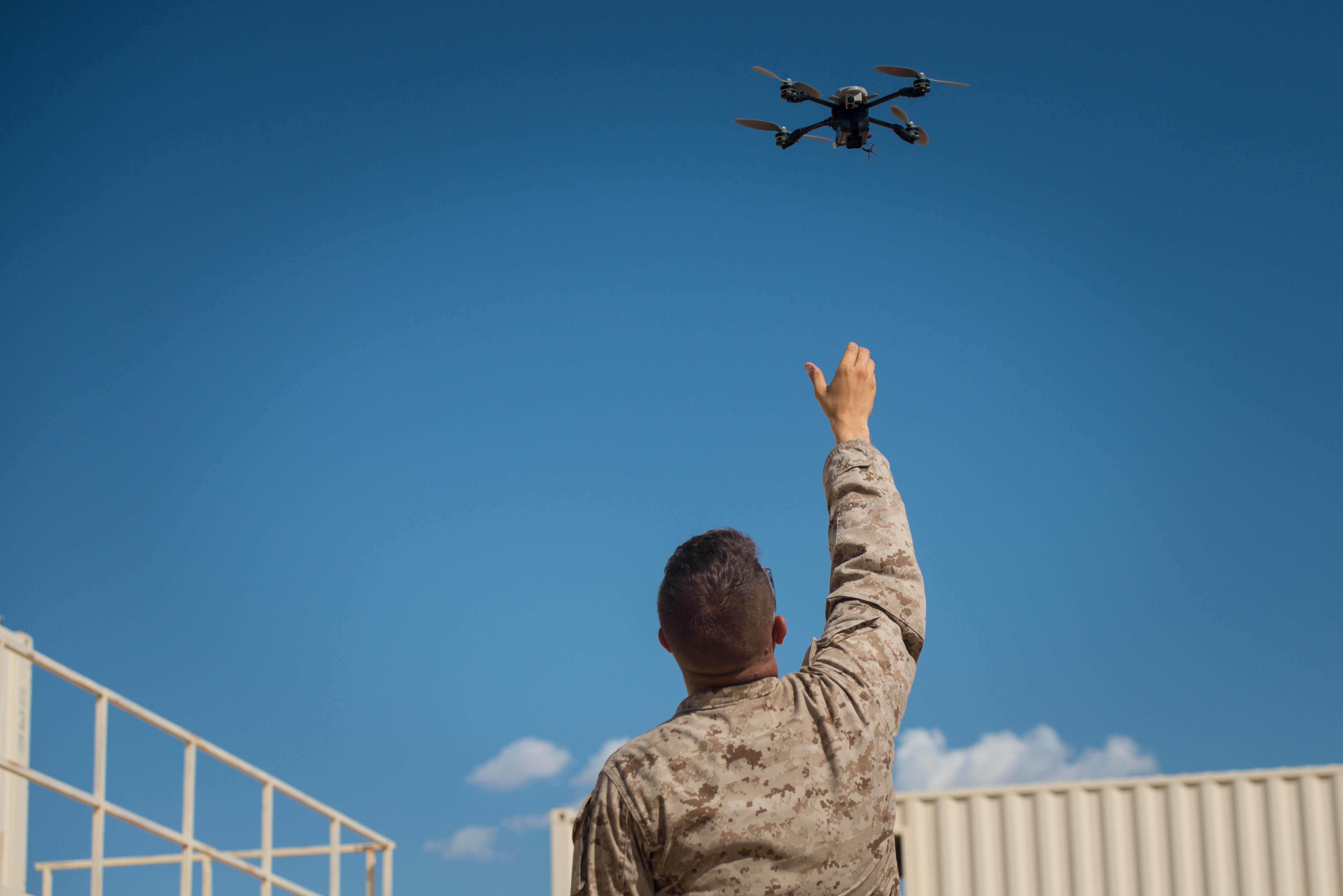 "A Marine with Kilo Company, 3rd Battalion, 5th Marine Regiment, assists his squad by providing reconnaissance with an ""Instant Eye"" unmanned aerial system at Marine Corps Air Ground Combat Center Twentynine Palms, Calif., July 31, 2016. US Marine Corps photo."