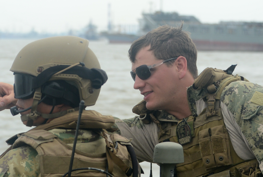 "Lt. David Nartker, right, assigned to Coastal Riverine Squadron (CRS) 3, talks with an Indonesian ""Kopaska"" Naval Special Forces on Aug. 6, 2015. US Navy Photo"
