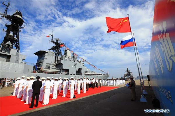 Chinese sailors welcome the Russian Navy destroyer Admiral Tributs (564) in Zhanjiang, China on Sept. 12, 2016. Xinhua Photo