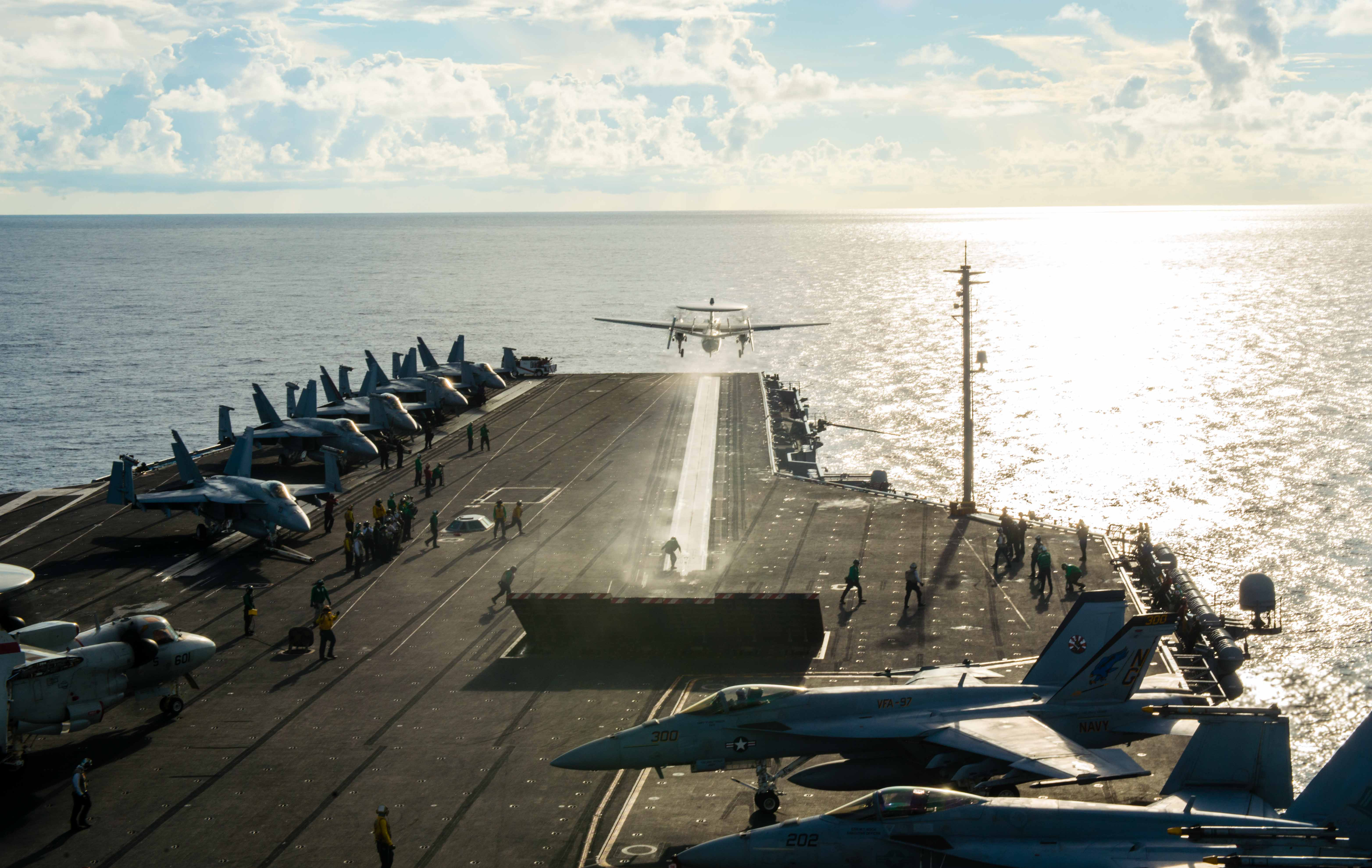 An E-2C Hawkeye assigned to the Golden Hawks of Airborne Early Warning Squadron (VAW) 112 launches from USS John C. Stennis' (CVN 74) flight deck with Chief of Naval Operations (CNO) Adm. John Richardson aboard on June 5, 2016. US Navy photo.