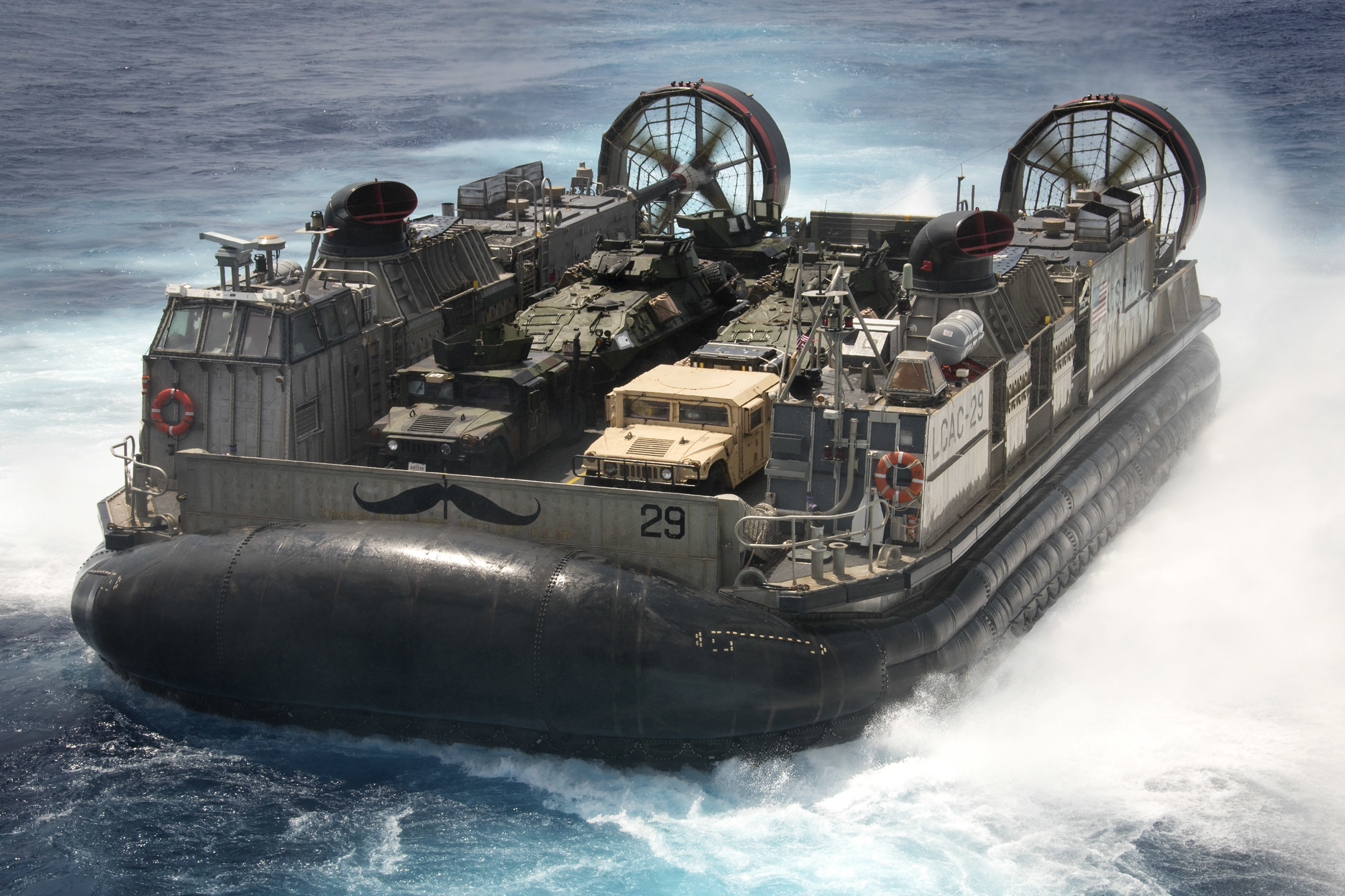 Landing craft air cushion (LCAC) 29, assigned to Naval Beach Unit (NBU) 7, disembarks from amphibious assault ship USS Bonhomme Richard (LHD 6) in the Philippine Sea on Sept. 11, 2016. US Navy photo.