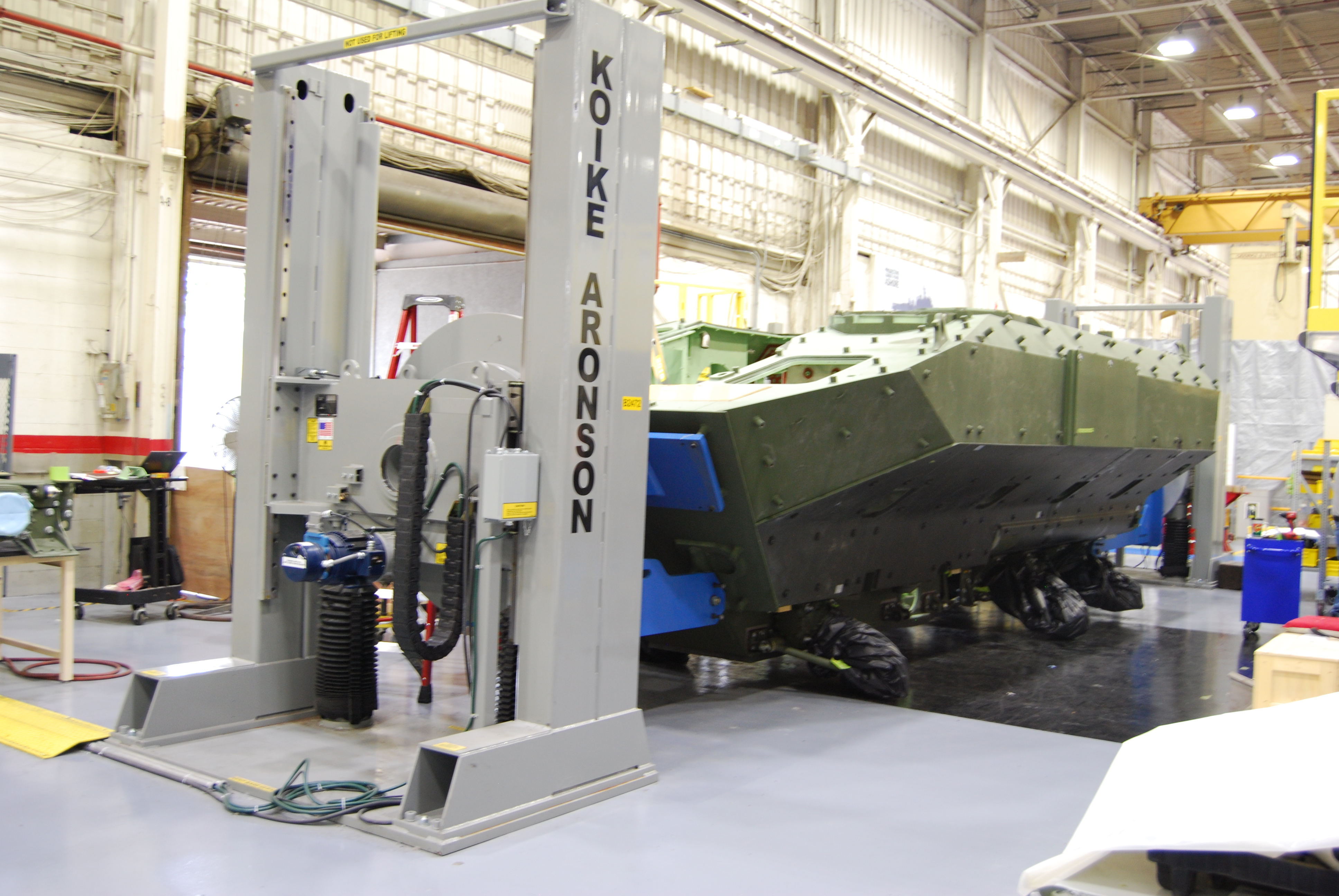BAE Systems' first production Amphibious Combat Vehicle is attached to a turnover fixture in the welding facility to allow workers to comfortably weld all sides of the vehicle. BAE Systems photo.
