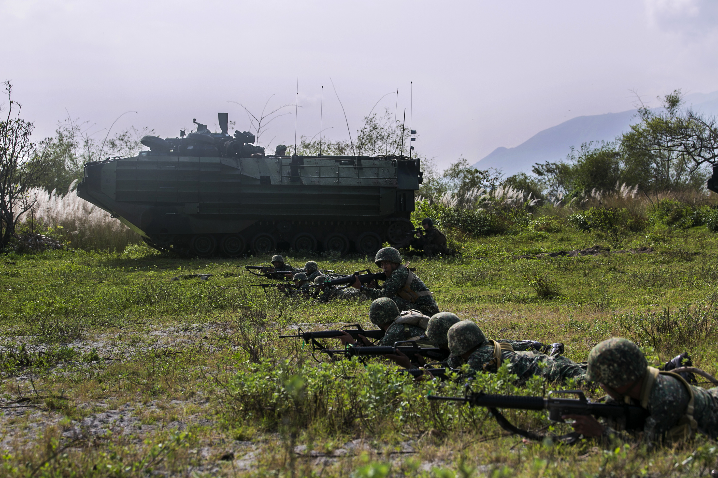Philippine and U.S. Marines provide supporting fire with U.S. Marine Amphibious Assault Vehicles to simulate suppressing enemy forces during a mechanized assault as part of Amphibious Landing Exercise 15 at Naval Education Training Command, Zambales, Luzon, Philippines in 2015. US Marine Corps Photo