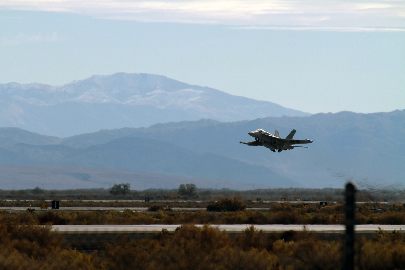 An F/A-18E Super Hornet assigned to the Knighthawks of Strike Fighter Squadron (VFA) 136 takes off from a runway on Naval Air Station Fallon on April 11, 2014. US Navy Photo