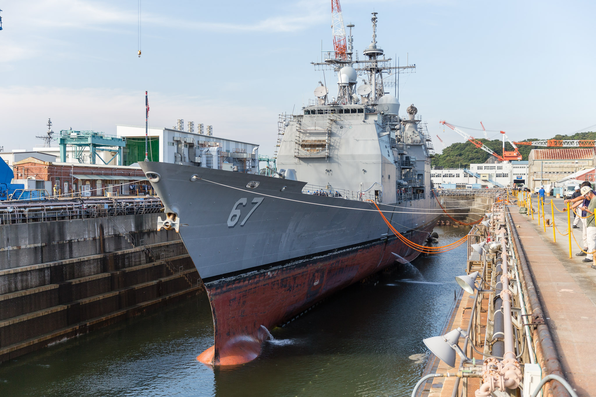 Water is drained from a dry dock at U.S. Naval Ship Repair Facility and Japan Regional Maintenance Center (SRF JRMC) Yokosuka on July 20, 2016. US Navy Photo