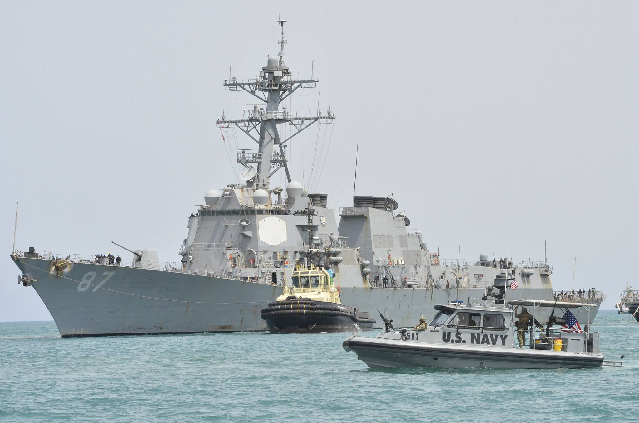 USS Mason (DDG-87) pulls into the Port of Djibouti escorted by Coastal Riverine Squadron 8 Sea Ark patrol boats on July 23, 2016. US Navy Photo