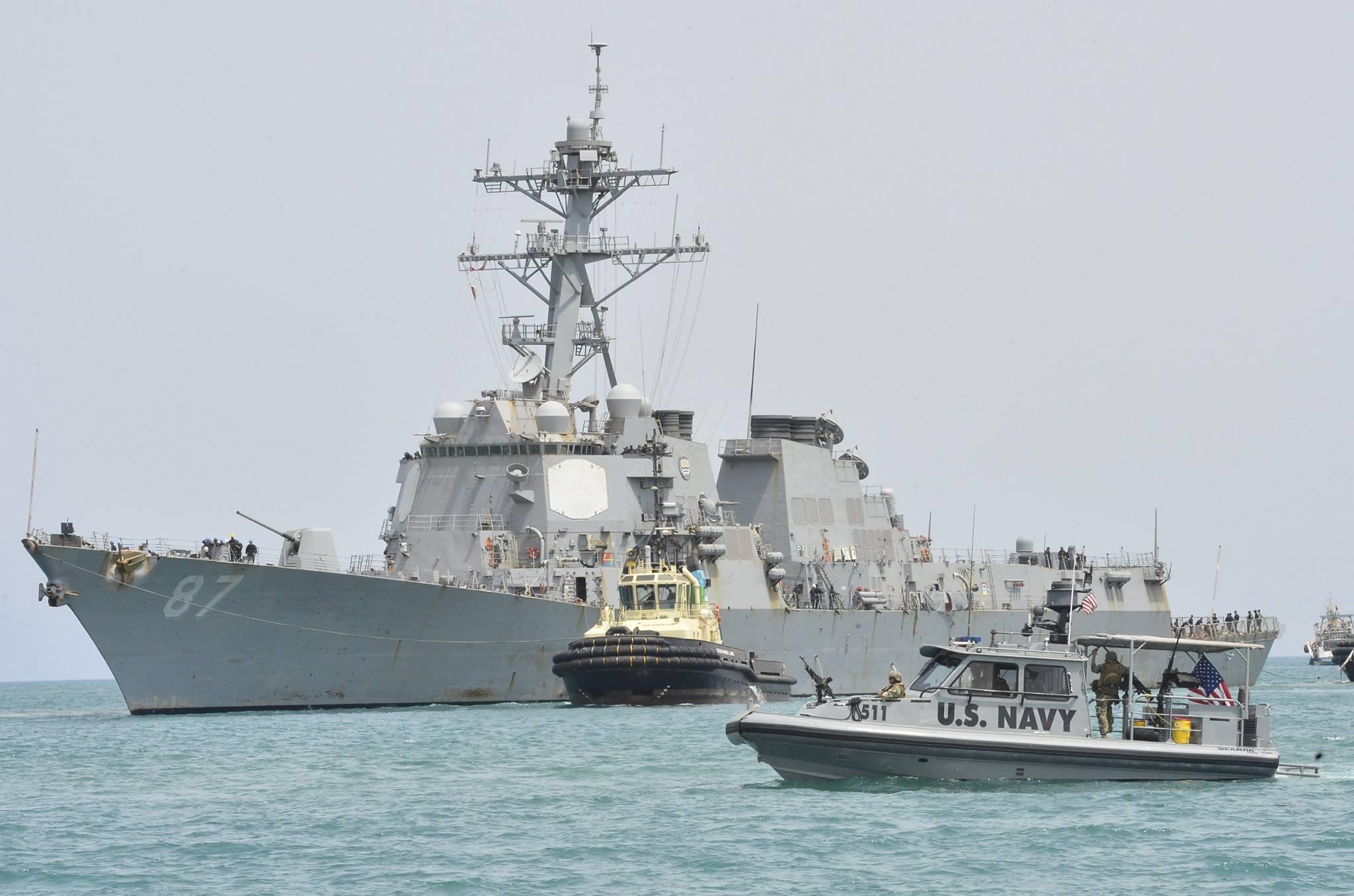 USS Mason (DDG-87) pulls into the Port of Djibouti escorted by Coastal Riverine Squadron 8 Sea Ark patrol boats on July 23, 2016. US Navy Photo