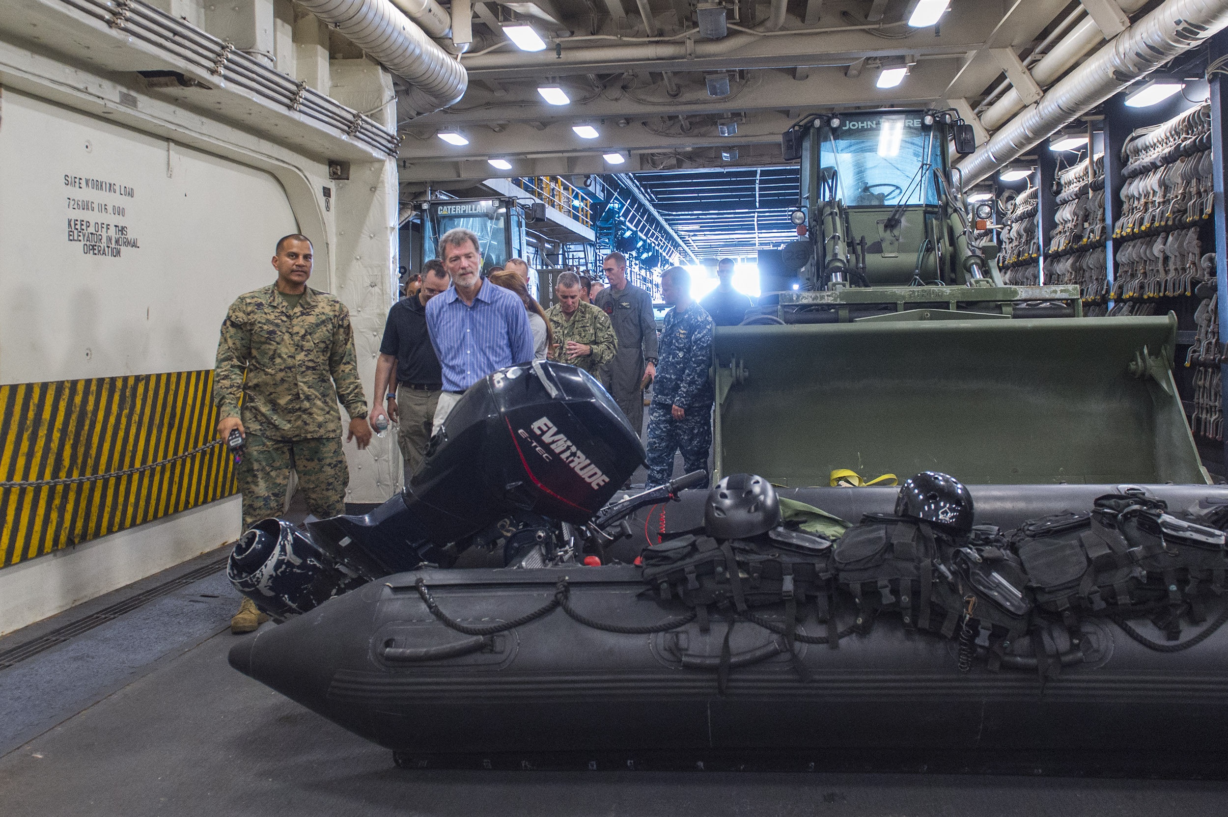 The Honorable Peter F. Mulrean, U.S. Ambassador to Haiti, tours the well deck of the amphibious transport dock ship USS Mesa Verde (LPD 19) on Oct. 9 to better understand the capabilities of Joint Task Force Matthew. US Navy photo.