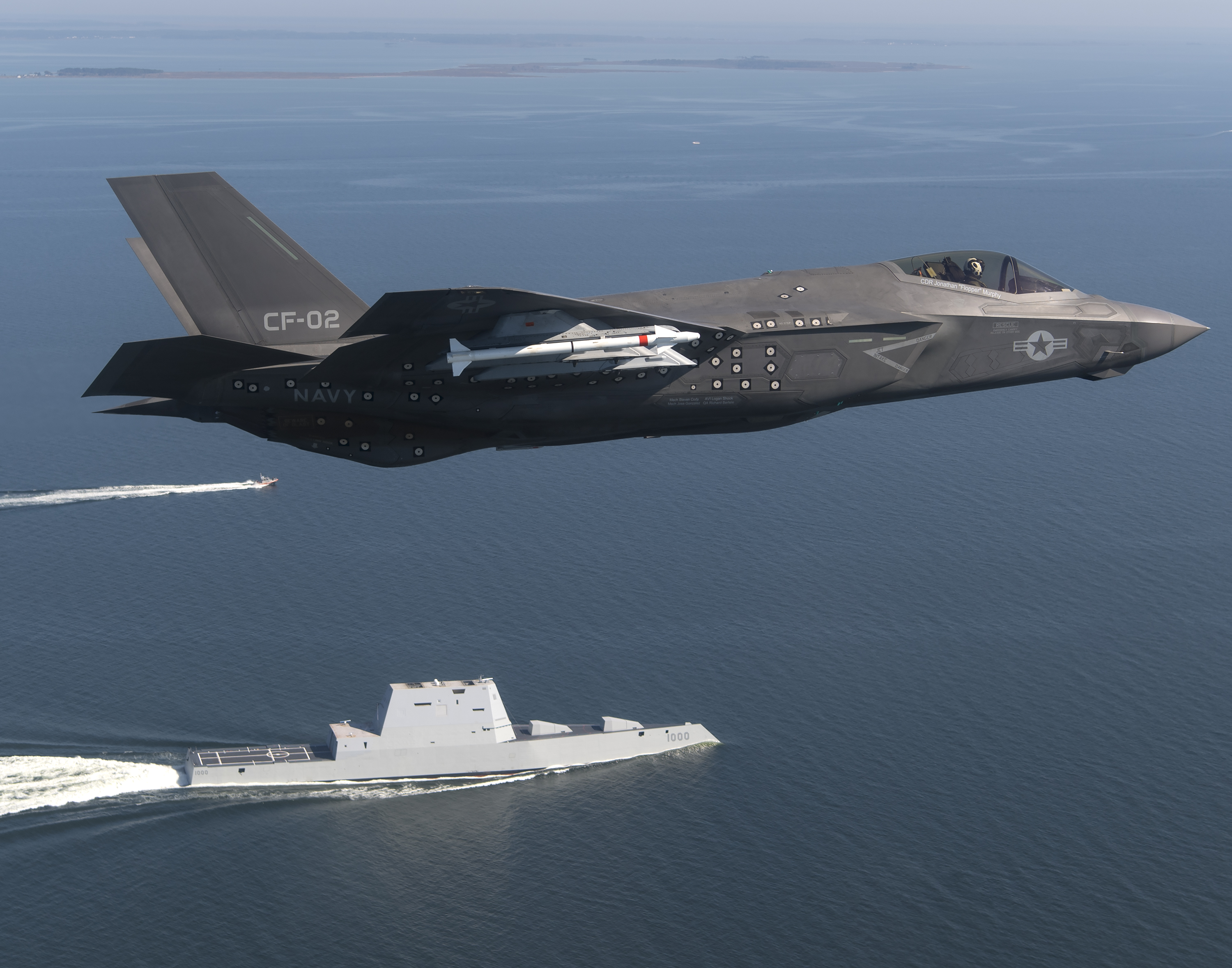 Aircraft CF-02, an F-35 Lightning II Carrier Variant attached to the F-35 Pax River Integrated Test Force (ITF) assigned to Air Test and Evaluation Squadron (VX) 23 completes a flyover of the guided-missile destroyer USS Zumwalt (DDG-1000). US Navy Photo