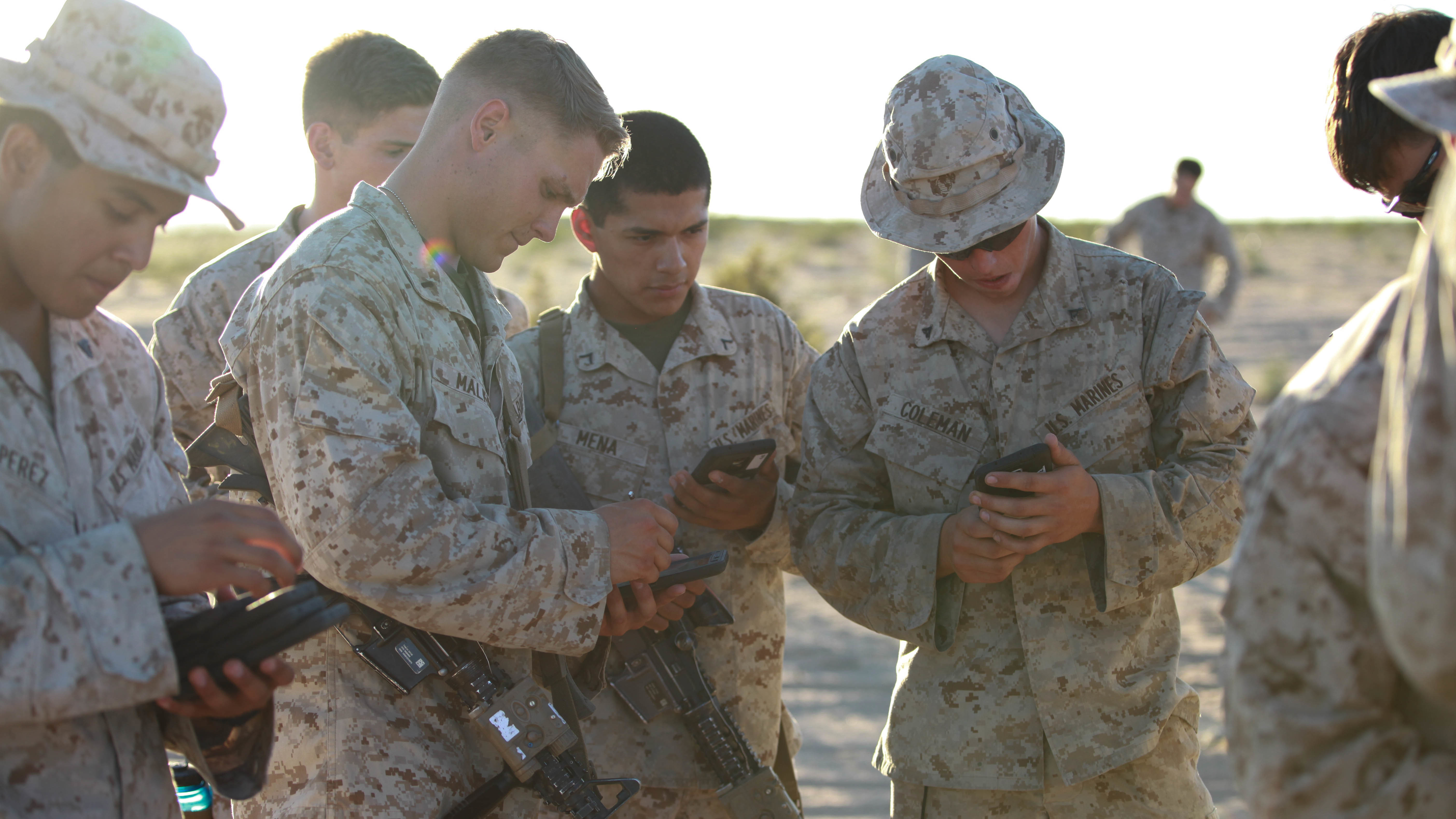 Marines with Fox Company, 2nd Battalion, 7th Marine Regiment use tablets to help them in a training exercise at Marine Corps Air Station Yuma, Ariz., Oct. 14, 2015. The tablets are wirelessly connected through an encrypted internal Wi-Fi network allowing Marines to coordinate and maneuver more efficiently in a tactical environment while securely using various applications on the devices. US Marine Corps photo.