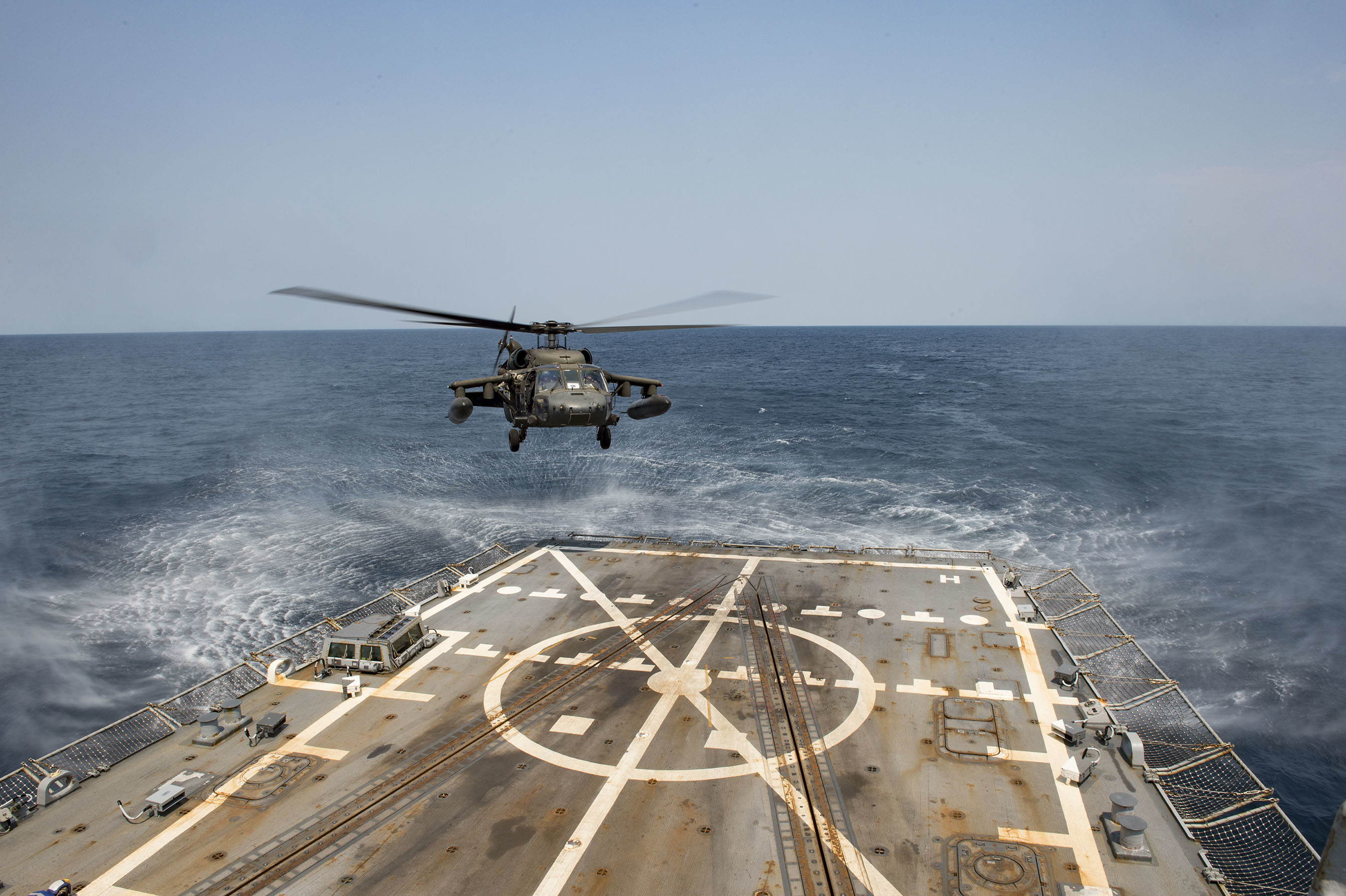 An Army UH-60 Blackhawk helicopter from the 1st Battalion, 228th Aviation Regiment lands on the flight deck aboard the Arleigh Burke-class guided-missile destroyer USS Lassen (DDG 82) while conducting deck landing qualifications (DLQs). Lassen is currently underway in support of Operation Martillo, a joint operation with the U.S. Coast Guard and partner nations within the 4th Fleet area of responsibility. SOUTHCOM commander Adm. Kurt Tidd said he's been pushing for greater inter-agency and international collaboration as well as innovation in his theater, all of which was showcased in Operation Martillo. US Navy photo.