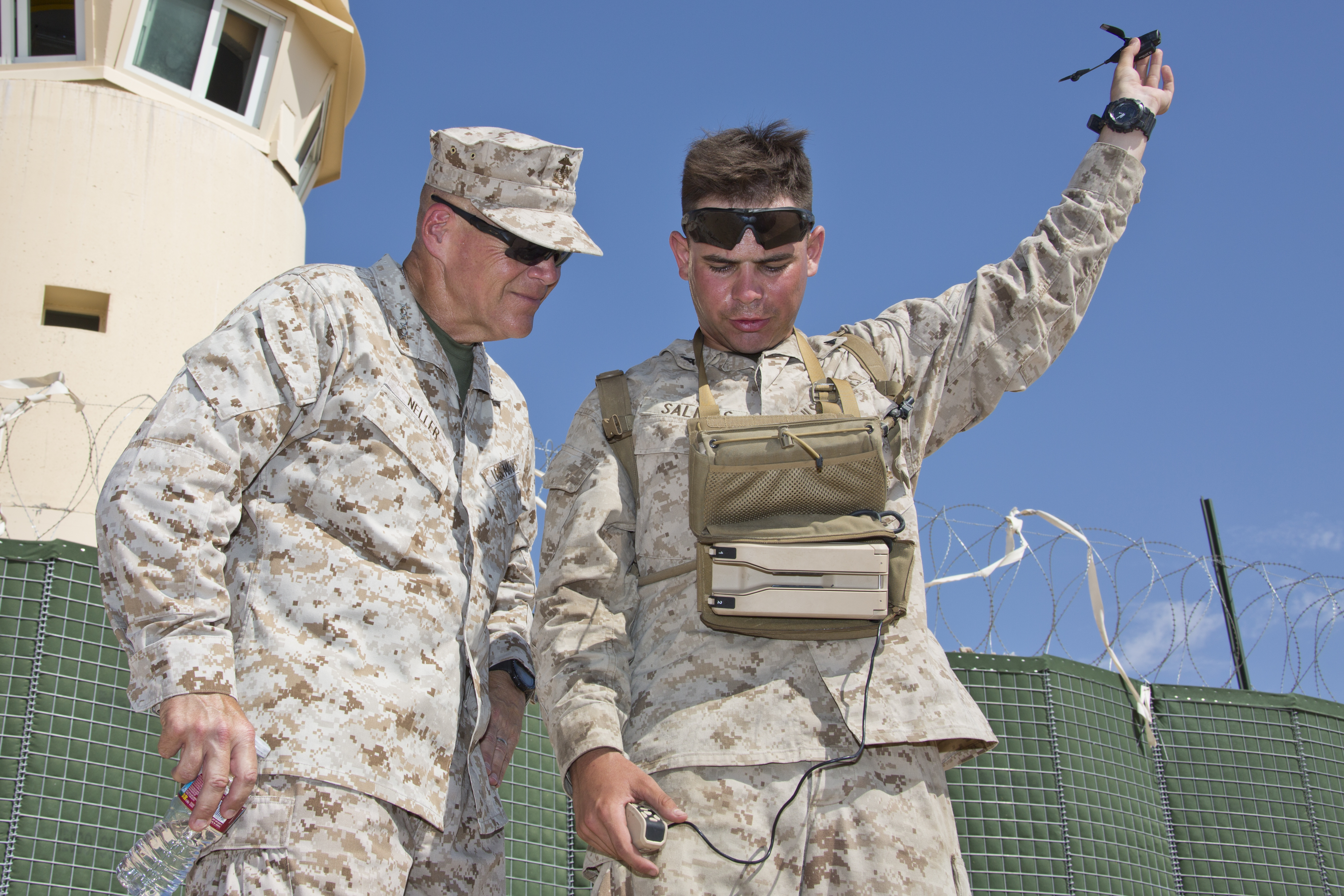 Commandant of the Marine Corps Gen. Robert B. Neller, left, speaks with Lance Cpl. Cesar H. Salinas, unmanned aerial system operator, at Twentynine Palms, Calif., July 28, 2016. Neller visited Twentynine Palms to observe Marines participating in the Marine Air-Ground Task Force Integrated Experiment (MIX-16). US Marine Corps photo.