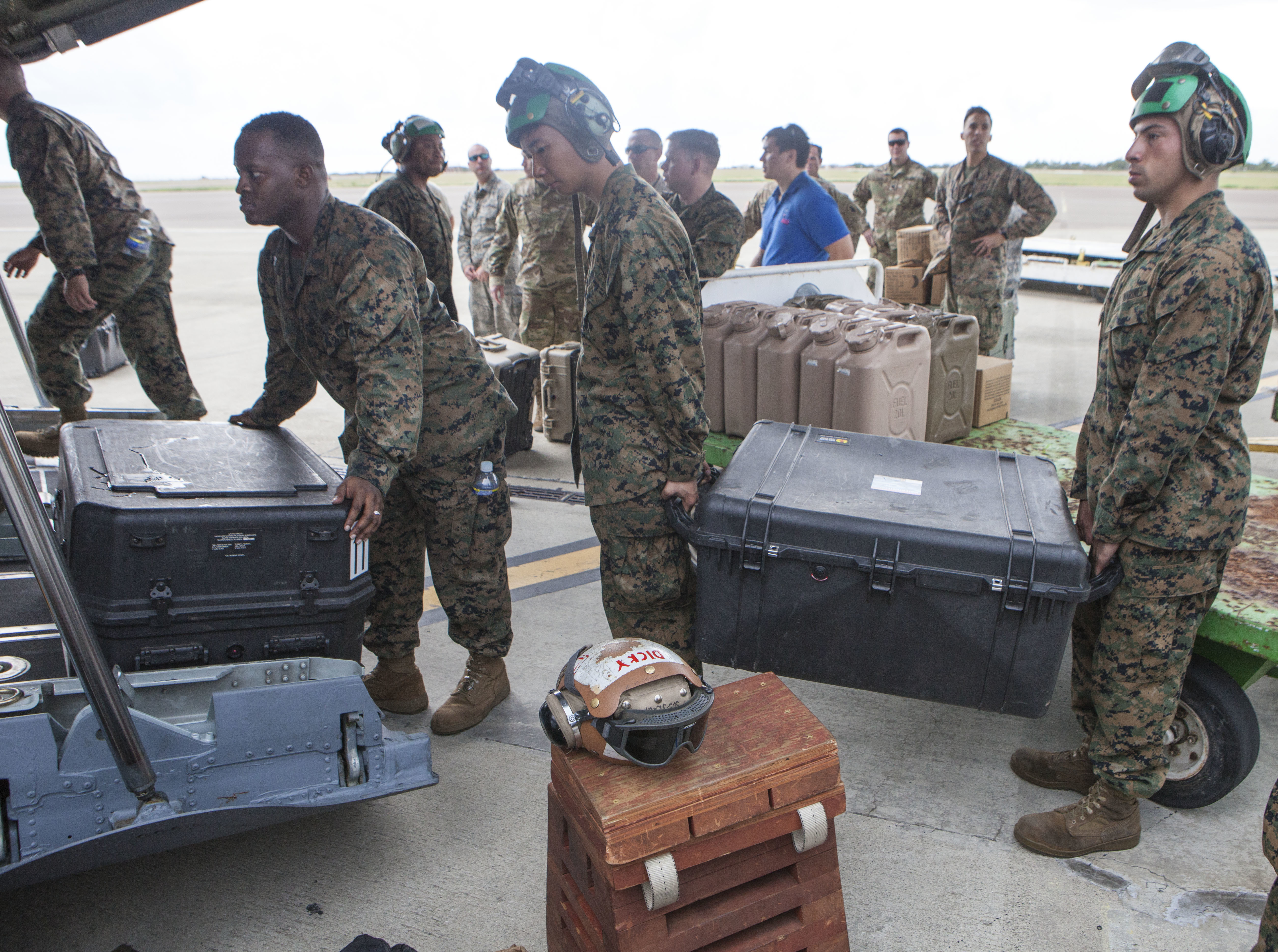 U.S. Marines with Special Purpose Marine Air-Ground Task Force - Southern Command and soldiers from 1st Battalion, 228th Aviation Regiment load an Ohio Air National Guard C-130H Hercules in preparation to depart their prepositioned location of Kingston, Jamaica, for Port-au-Prince, Haiti, to support the humanitarian assistance and disaster relief effort in response to Hurricane Matthew, Oct. 5, 2016. US Marine Corps photo.