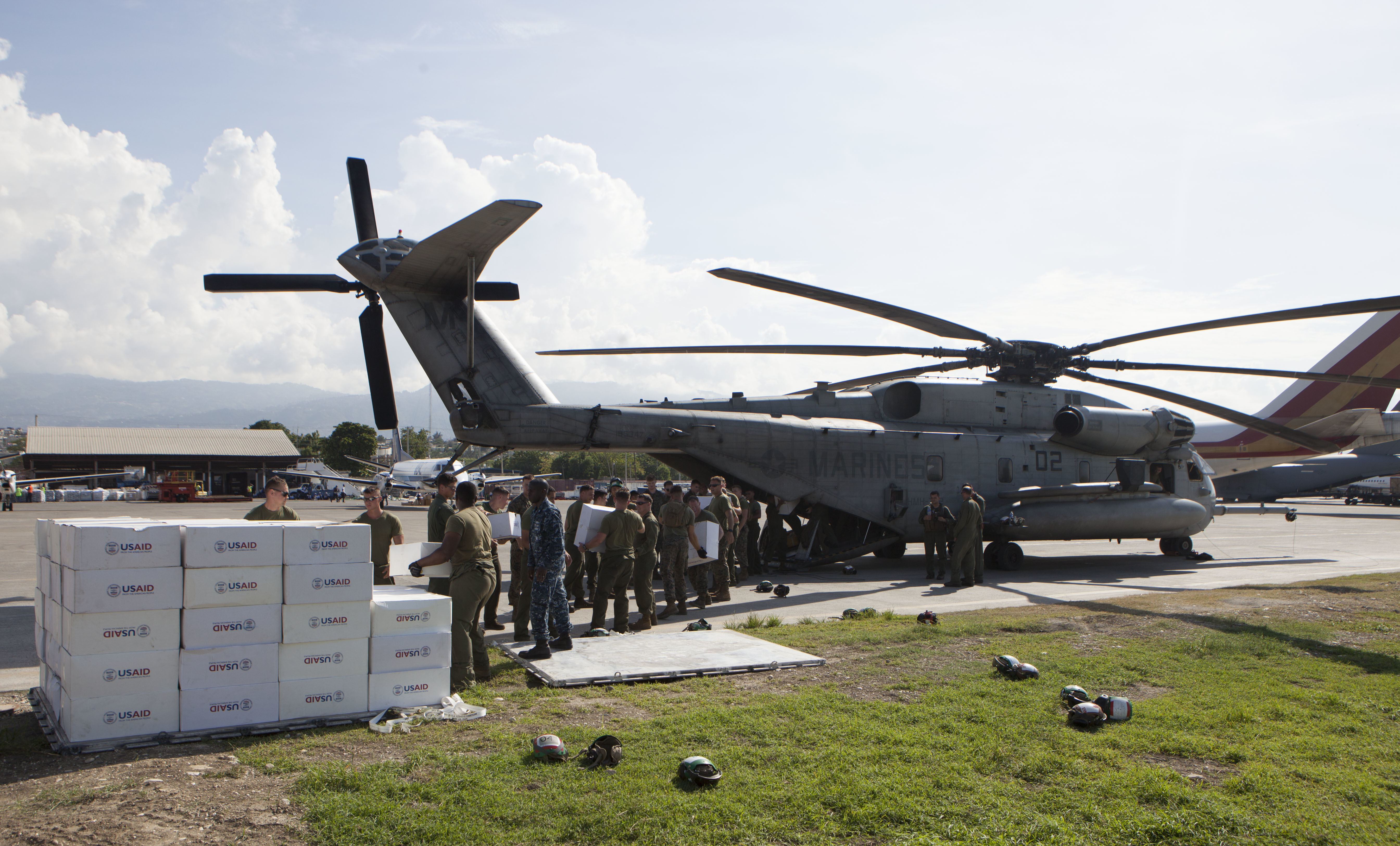 U.S. Marines with Special Purpose Marine Air-Ground Task Force-Southern Command deployed in support of Joint Task Force Matthew, load boxes from United States Agency of International Development aboard a CH-53E Super Stallion helicopter in preparation to deliver the supplies to locals affected by Hurricane Matthew at Port-au-Prince, Haiti, Oct. 10, 2016. US Marine Corps photo.