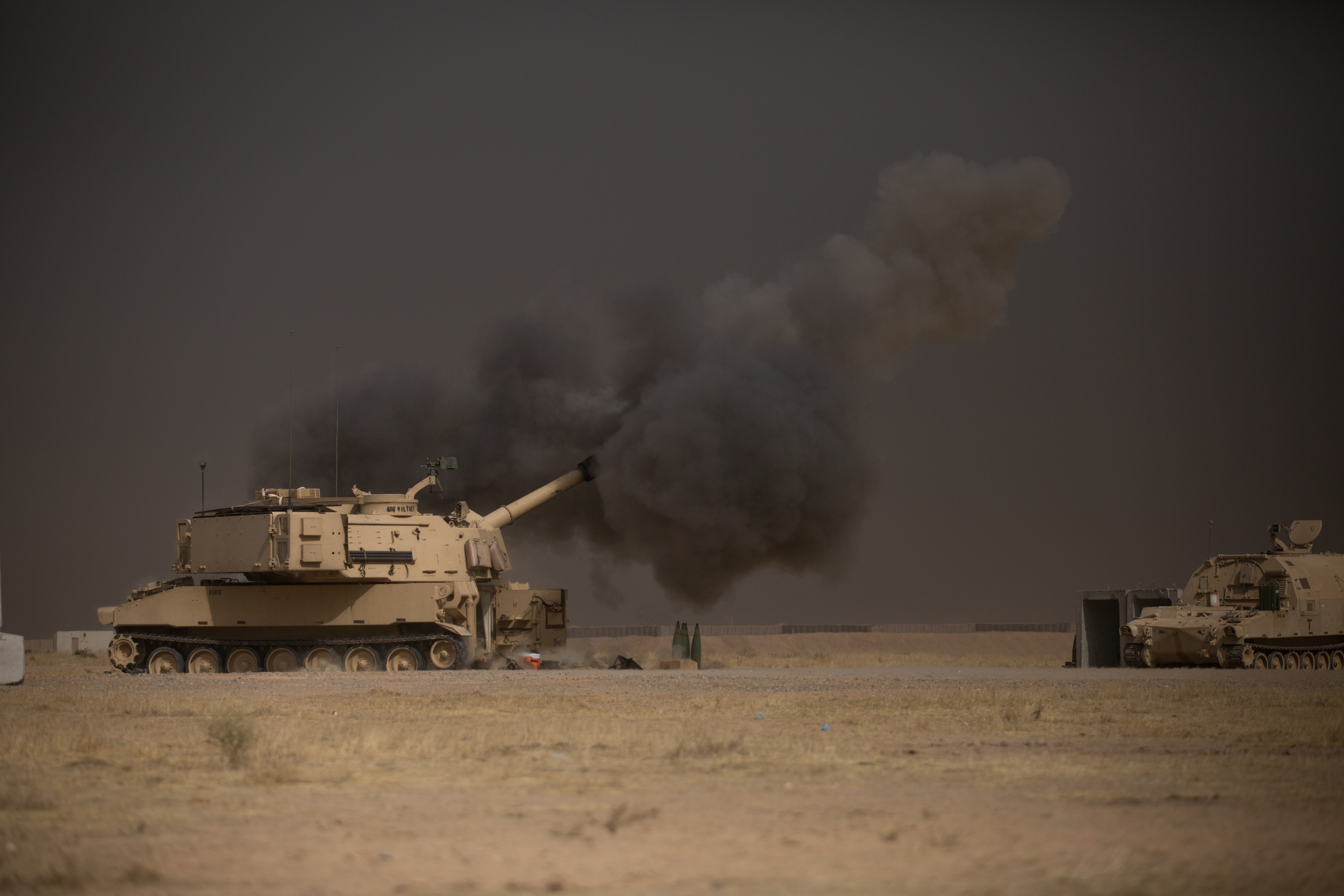 A U.S. Army M109A6 Paladin conducts a fire mission at Qayyarah West, Iraq, in support of the Iraqi security forces' push toward Mosul, Oct. 17, 2016. US Army photo.