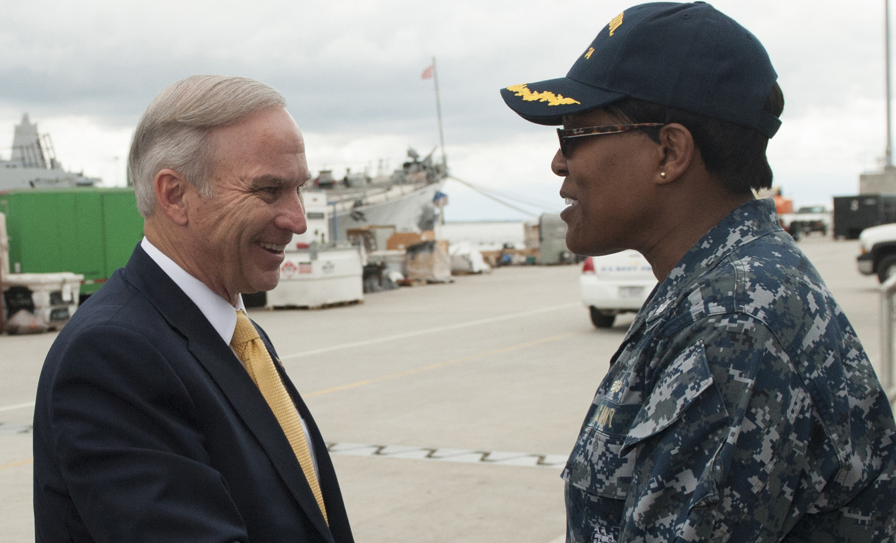 Cmdr. Janet H. Days, USS McFaul (DDG-74) Executive Officer, greets Chairman Randy Forbes of the House Armed Services' Seapower and Projection Forces Subcommittee prior to a tour aboard Mcfaul on May 23, 2016. US Navy Photo