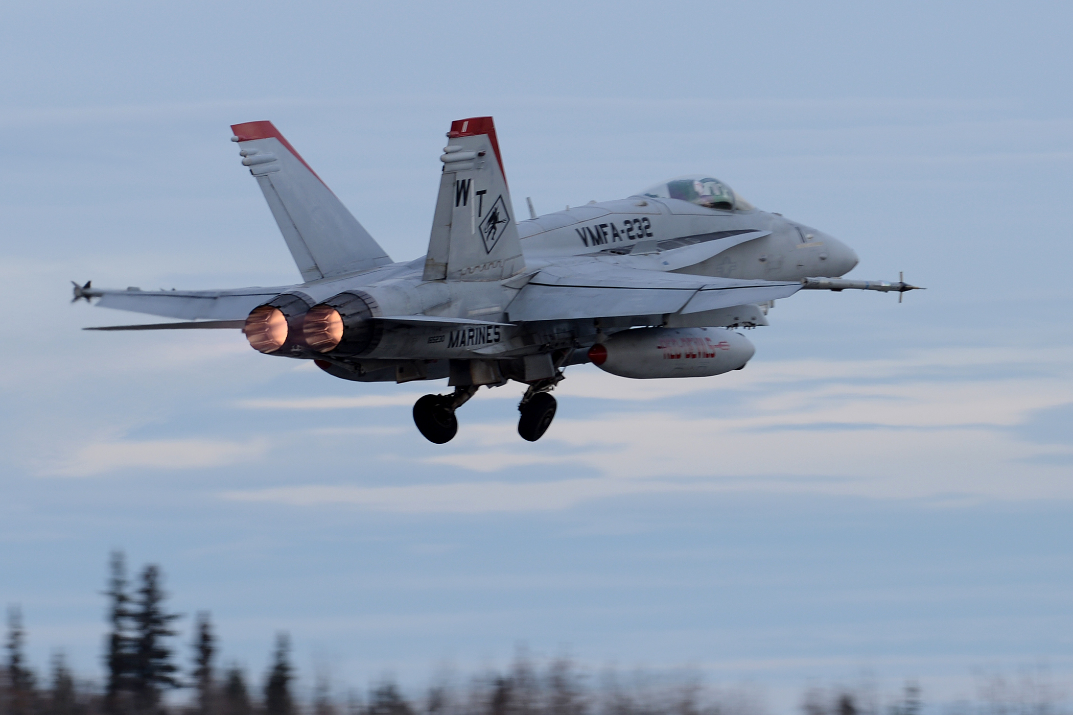 A U.S. Marine Corps F/A-18C Hornet aircraft from Marine Fighter Attack Squadron 232 out of Marine Corps Air Station Miramar, Calif., takes off from Eielson Air Force Base, Alaska, Oct. 10, 2016, for the first RED FLAG-Alaska (RF-A) 17-1 combat training mission. US Air Force photo.