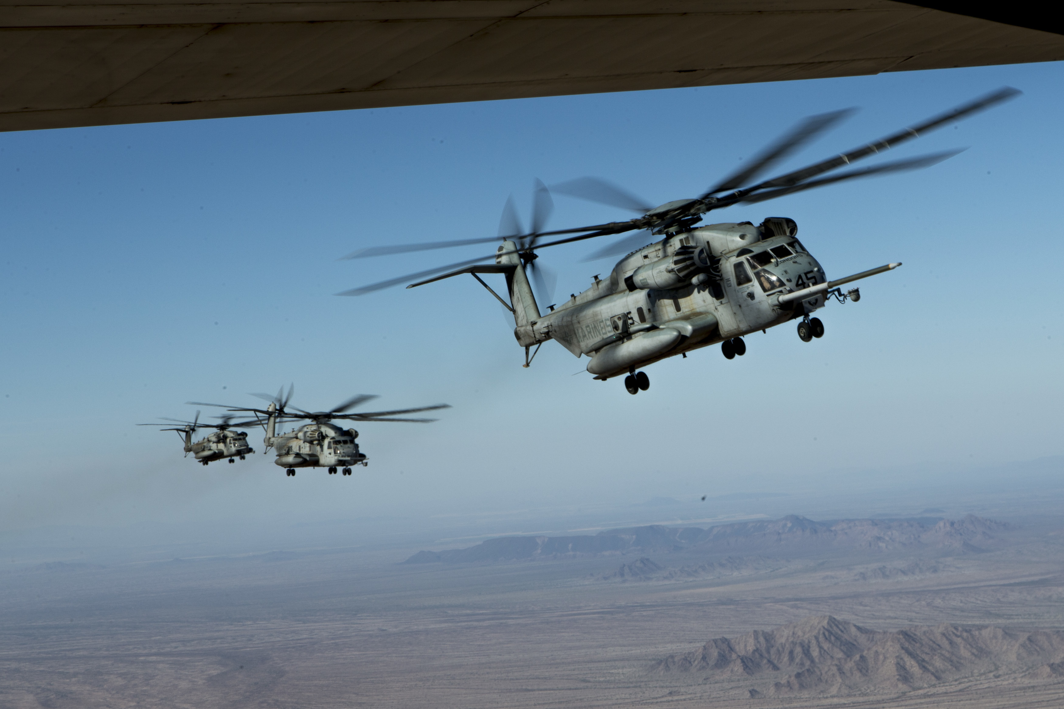 U.S. Marine Corps CH-53E Super Stallions assigned to Marine Aviation Weapons and Tactics Squadron One (MAWTS-1) fly in formation during FINEX-3 near Yuma, Ariz., Oct. 22, 2016. FINEX-3 was part of Weapons Tactics Instructors (WTI) course 1-17, a seven week training event hosted by MAWTS-1 cadre which emphasizes operational integration of the six functions of Marine Corps aviation in support of a Marine Air Ground Task Force. MAWTS-1 provides standardized advanced tactical training and certification of unit instructor qualifications to support Marine aviation Training and Readiness and assists in developing and employing aviation weapons and tactics. (U.S. Marine Corps photo by Lance Cpl. Andrew Huff)