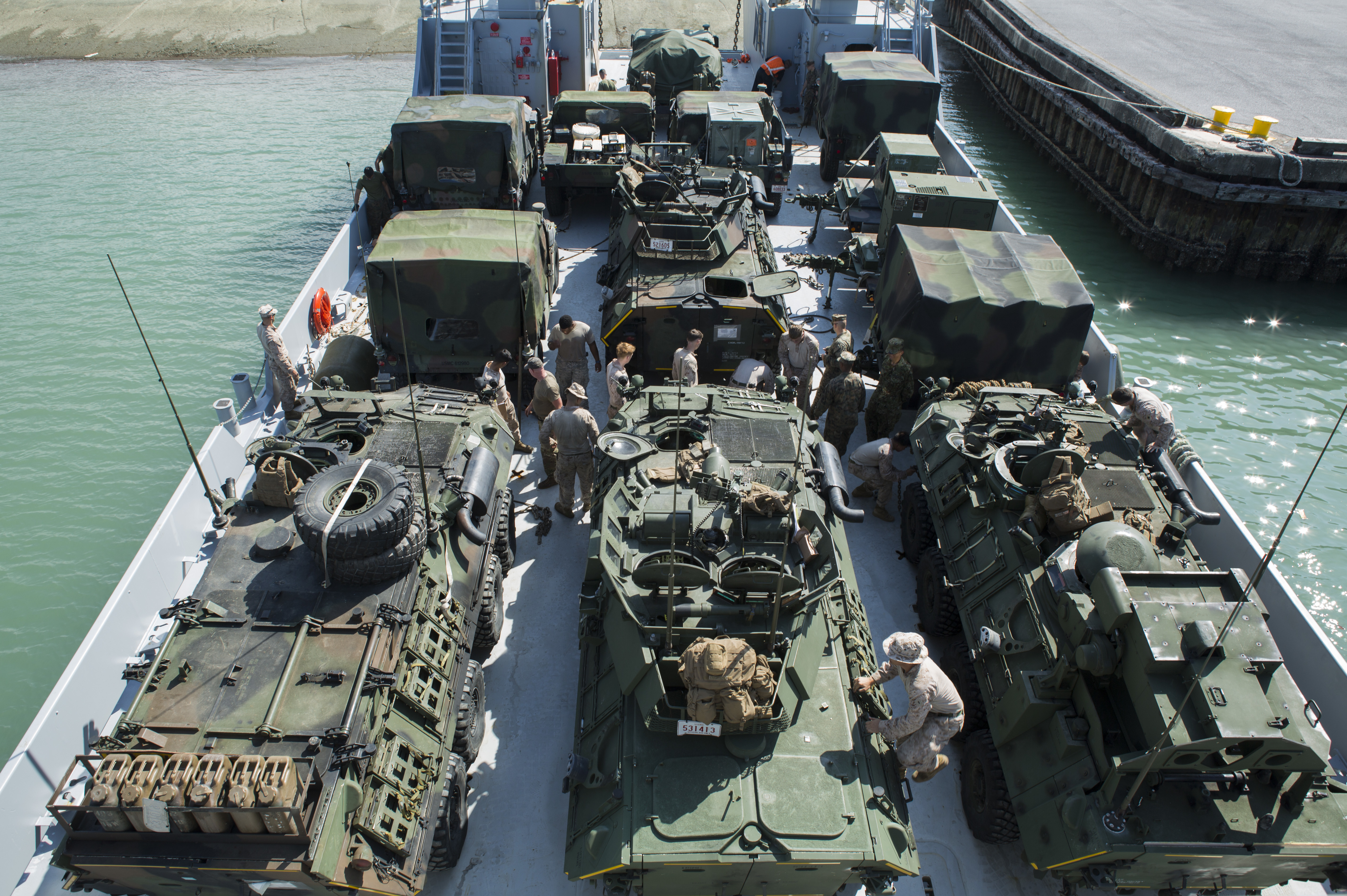 U.S. service members load Humvees onto the USAV Harpers Ferry, Runnymede-class large landing craft, at Naha Port, Okinawa, Japan during Blue Chromite 2017, October 31, 2016. Blue Chromite is a U.S. – only exercise which strengthens the Navy-Marine Corps expeditionary, amphibious rapid-response capabilities based in Okinawa and the greater Indo-Asia-Pacific region. (U.S. Marine Corps photo by MCIPAC Combat Camera Lance Cpl. Tiana Boyd)