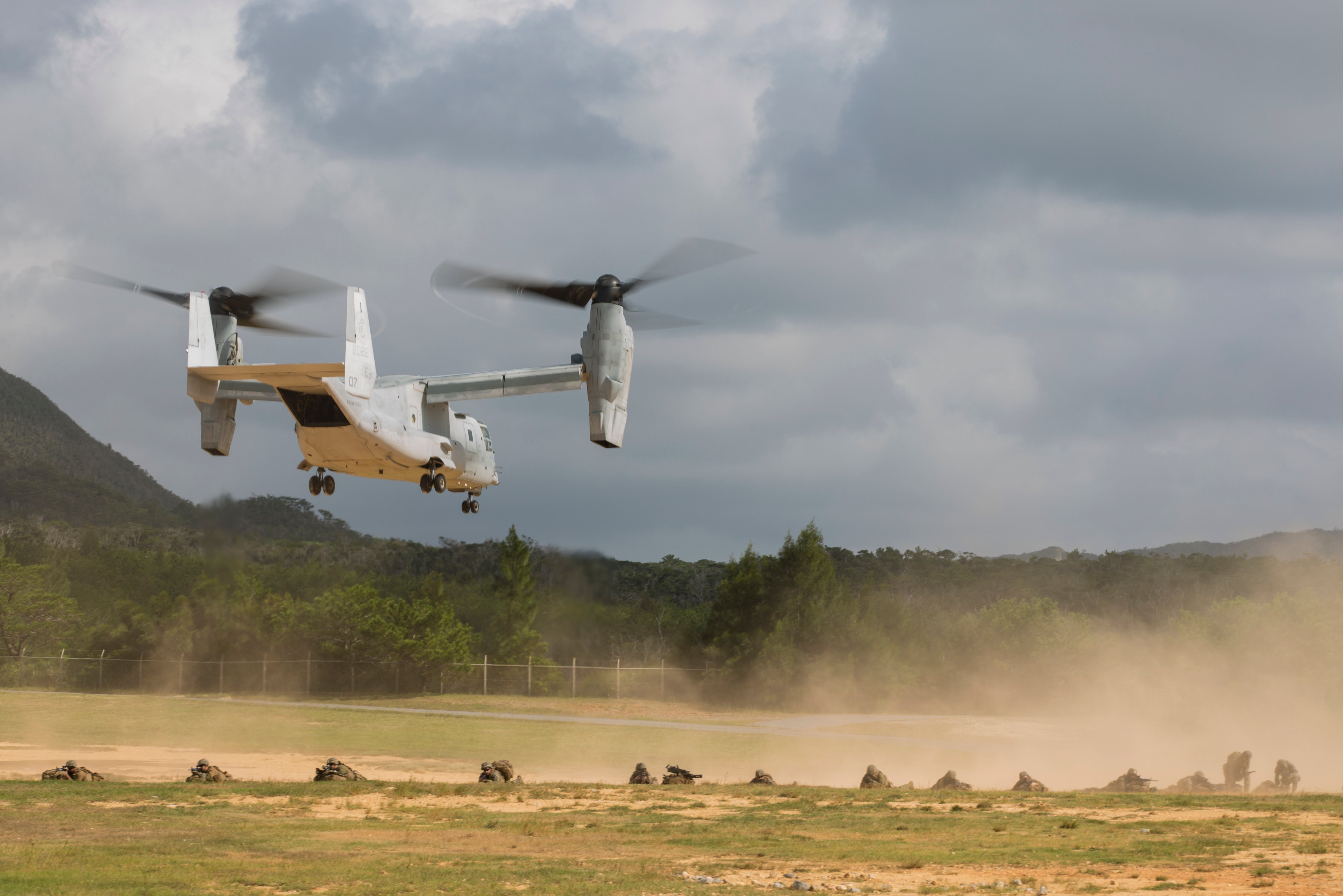 U.S. Marines assigned with 3rd Battalion, 3rd Marine Regiment, which is forward deployed from Kaneohe Bay, Hawaii provide security as an MV-22B Osprey tiltrotor aircraft from Marine Medium Tiltrotor Squadron 265, Marine Aircraft Group 36, 1st Marine Aircraft Wing, flies overhead during an air assault drill as part of Blue Chromite 2017, Okinawa, Japan, November 1, 2016. Blue Chromite is a U.S. – only exercise which strengthens the Navy-Marine Corps expeditionary, amphibious rapid-response capabilities based in Okinawa and the greater Indo-Asia-Pacific region. (U.S. Marine Corps photo by MCIPAC Combat Camera Lance Cpl. Tiana Boyd)