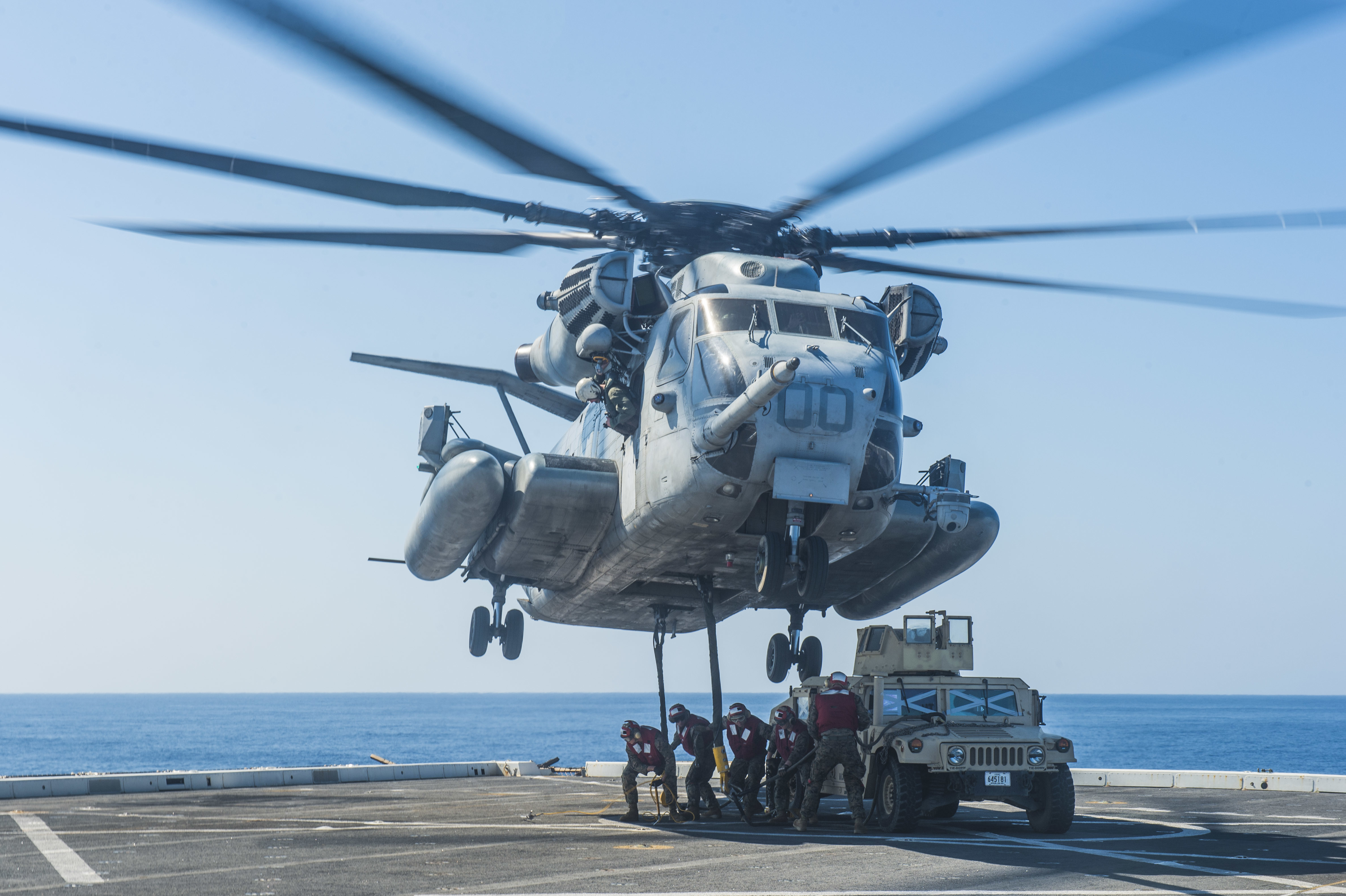 161031-N-XM324-095 WATERS OUTSIDE OKINAWA (Oct. 31, 2016) Marines, assigned to 3rd Battalion, 3rd Marine Regiment, attach a Humvee to a CH-53E Super Stallion helicopter, assigned to the 1st Marine Aircraft Wing, from the flight deck of the amphibious transport dock ship USS Green Bay (LPD 20) during Blue Chromite. Blue Chromite is a U.S.-only exercise, which strengthens the Navy-Marine Corps expeditionary, amphibious rapid-response capabilities based in Okinawa, Japan and the greater Indo-Asia-Pacific region. (U.S. Navy photo by Petty Officer 3rd Class Patrick Dionne/Released)