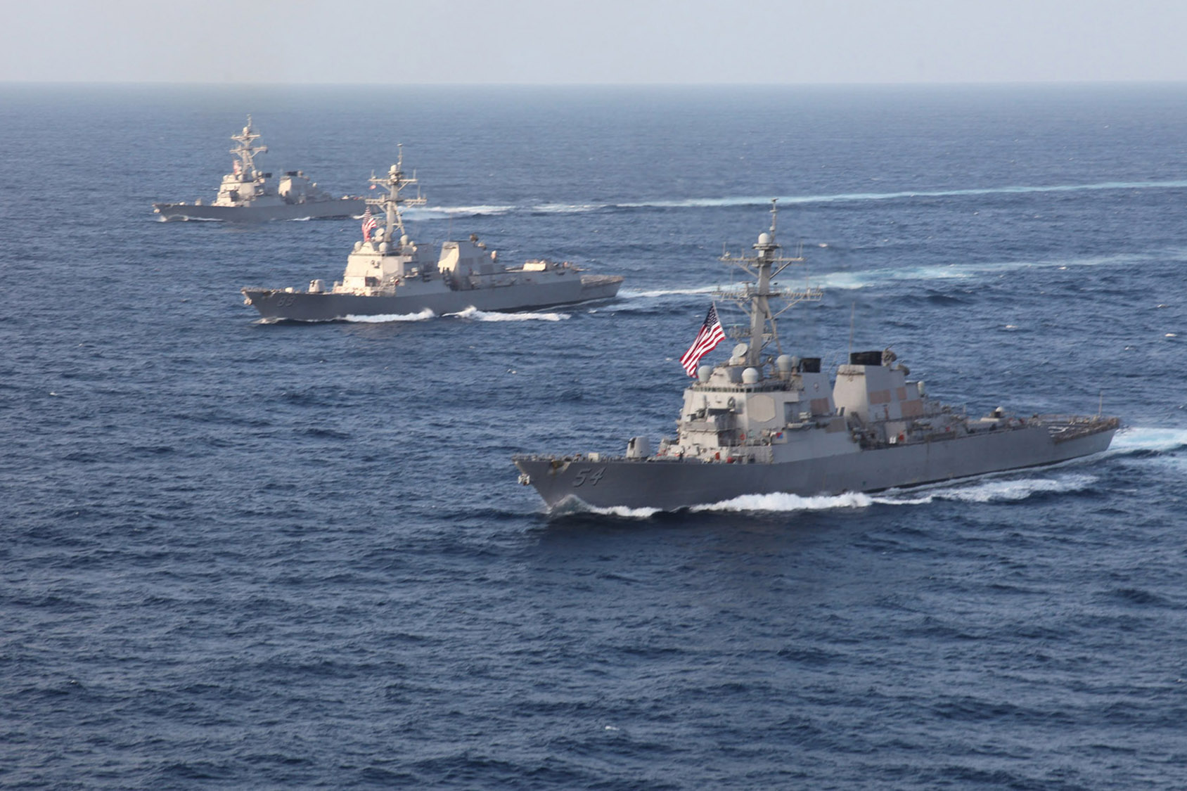 Ships assigned to Destroyer Squadron 15 (DESRON 15) sail in formation in 2012. US Navy Photo