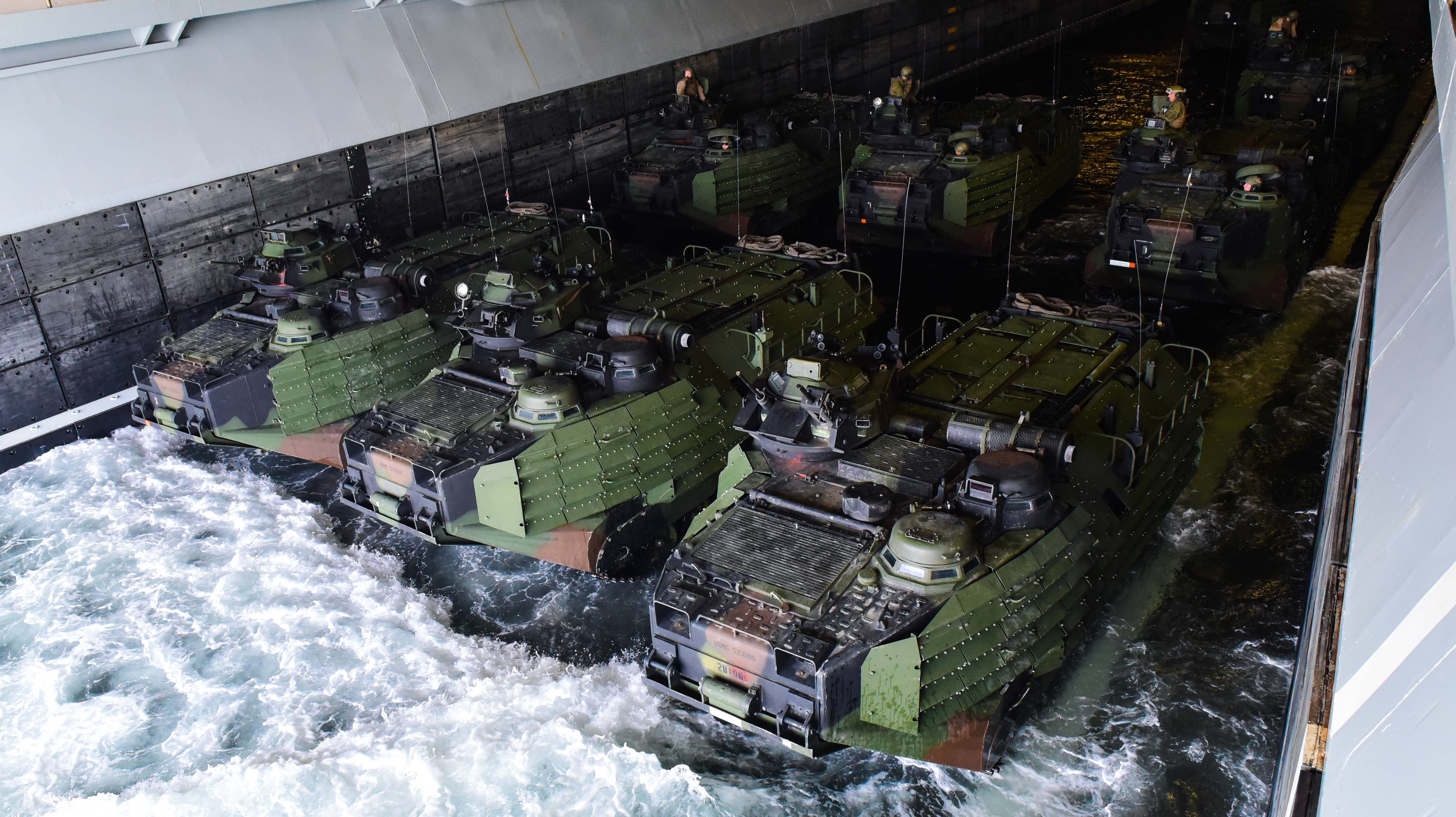 U.S. Marines prepare to depart the amphibious assault ship USS Bataan (LHD 5) in amphibious assault vehicles (AAV) in April 2016. US Navy photo.