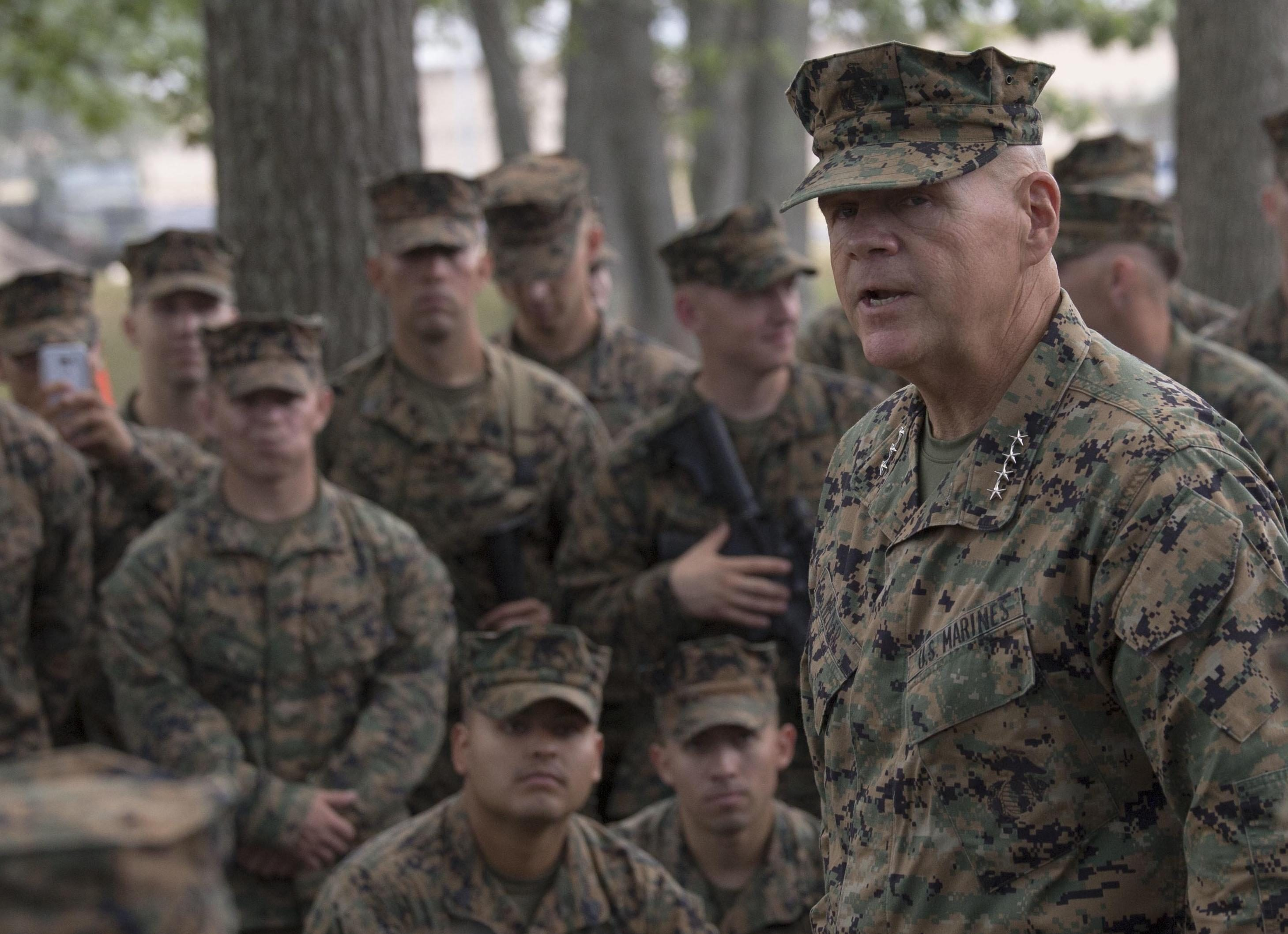 Gen. Robert B. Neller, Commandant of the Marine Corps, speaks with a group of Marines from Marine Forces Reserve on Aug. 24, 2016. US Marine Corps Photo