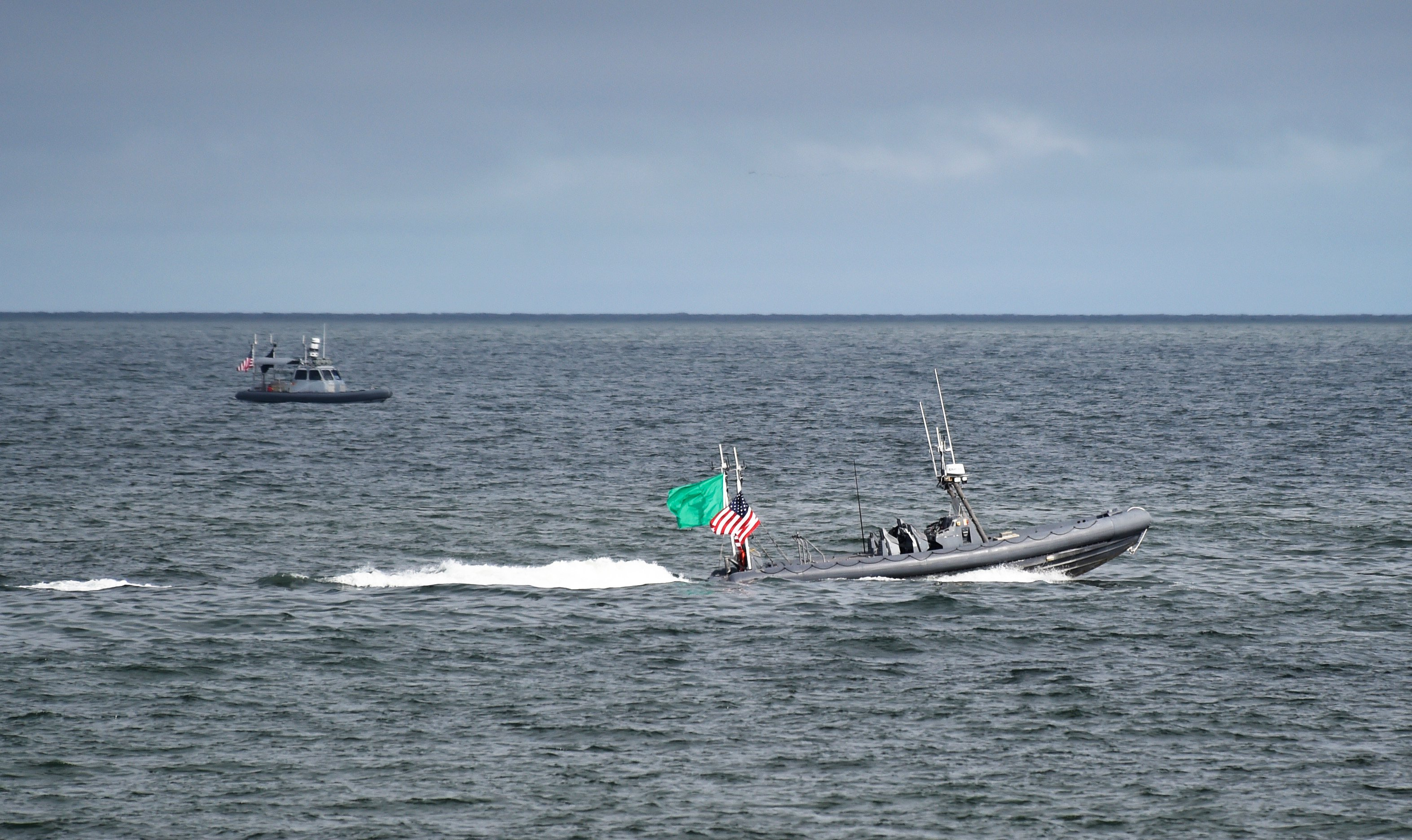 Two unmanned rigid-hull inflatable boats operate autonomously during an Office of Naval Research (ONR)-sponsored demonstration of swarmboat technology held at Joint Expeditionary Base Little Creek-Fort Story on Sept. 30, 2016. US Navy photo.
