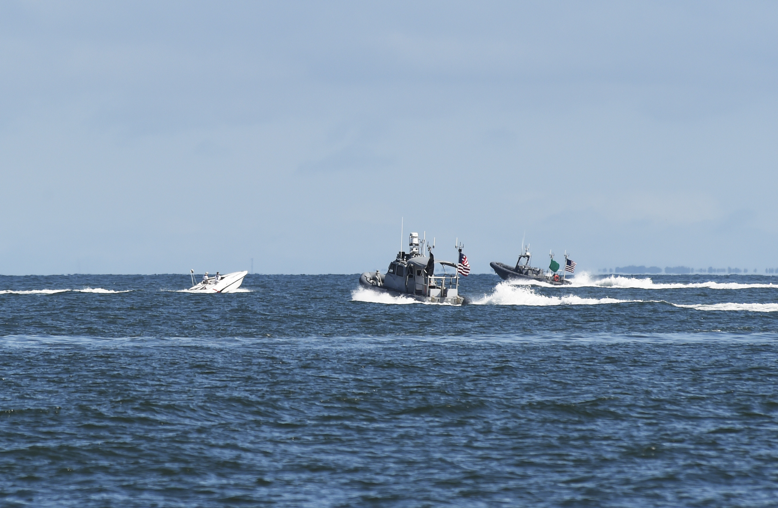 Unmanned rigid-hull inflatable boats operating autonomously close in on a contact of interest during an Office of Naval Research (ONR)-sponsored demonstration of swarmboat technology held at Joint Expeditionary Base Little Creek-Fort Story on Sept. 30, 2016. US Navy photo.
