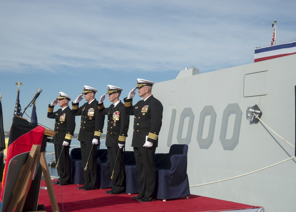 Vice Adm. Thomas Rowden, commander, Naval Surface Forces, Capt. James A. Kirk, outgoing commanding officer (CO) of guided-missile destroyer USS Zumwalt (DDG-1000), Capt. Scott A. Tait, in-coming CO of Zumwalt, and Capt. W. Kyle Fauntleroy, Force Chaplain, Surface Force, U.S. Pacific Fleet, salute the ensign during a change of command ceremony at Naval Base San Diego on Dec. 20, 2016. US Navy Photo
